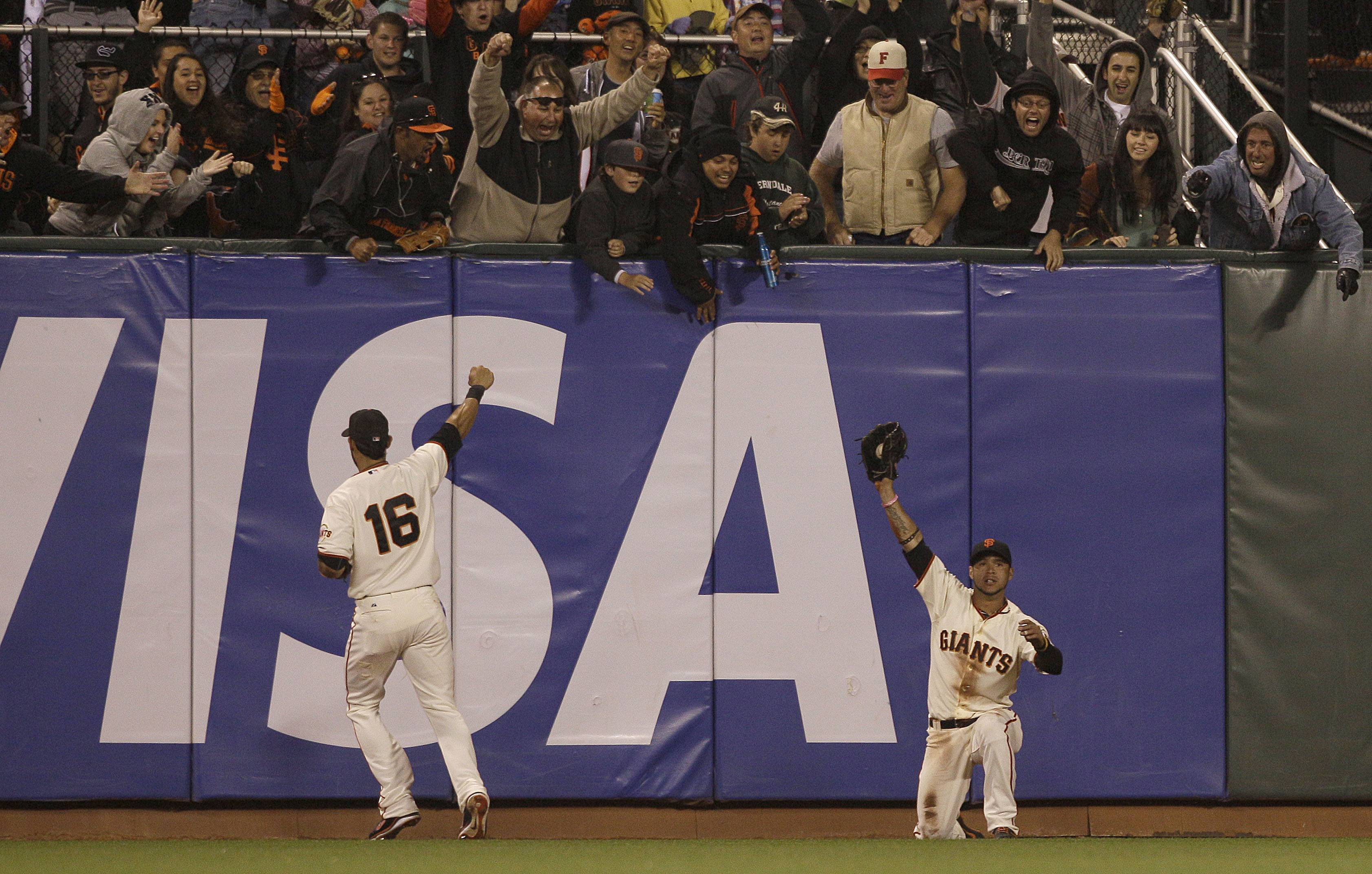 San Francisco Giants center fielder Gregor Blanco, right, celebrates with left fielder Angel Pagan after catching a fly ball hit by the Houston Astros' Jordan Schafer Wednesday during the seventh inning.