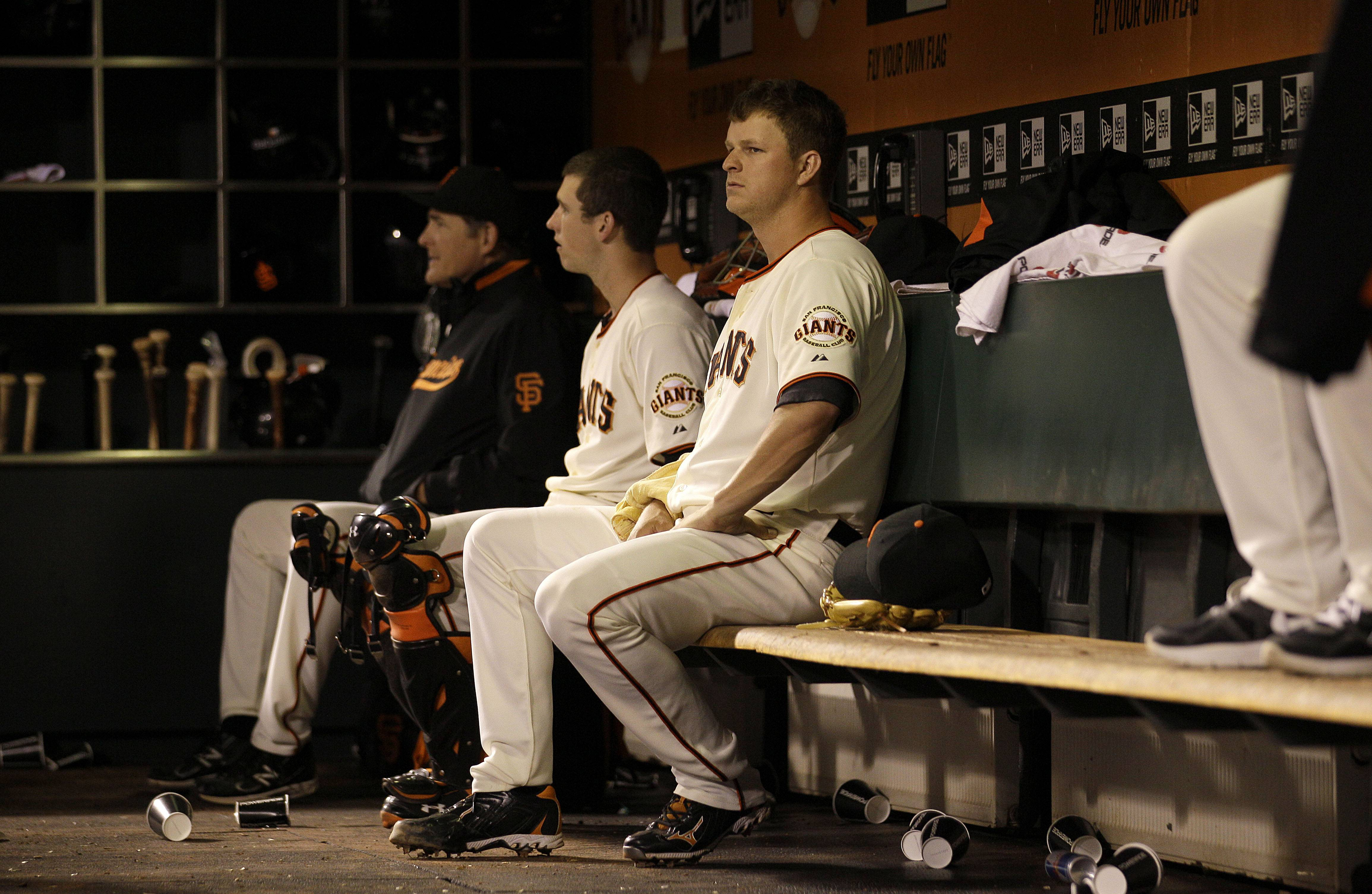 San Francisco Giants pitcher Matt Cain sits in the dugout Wednesday during the sixth inning.