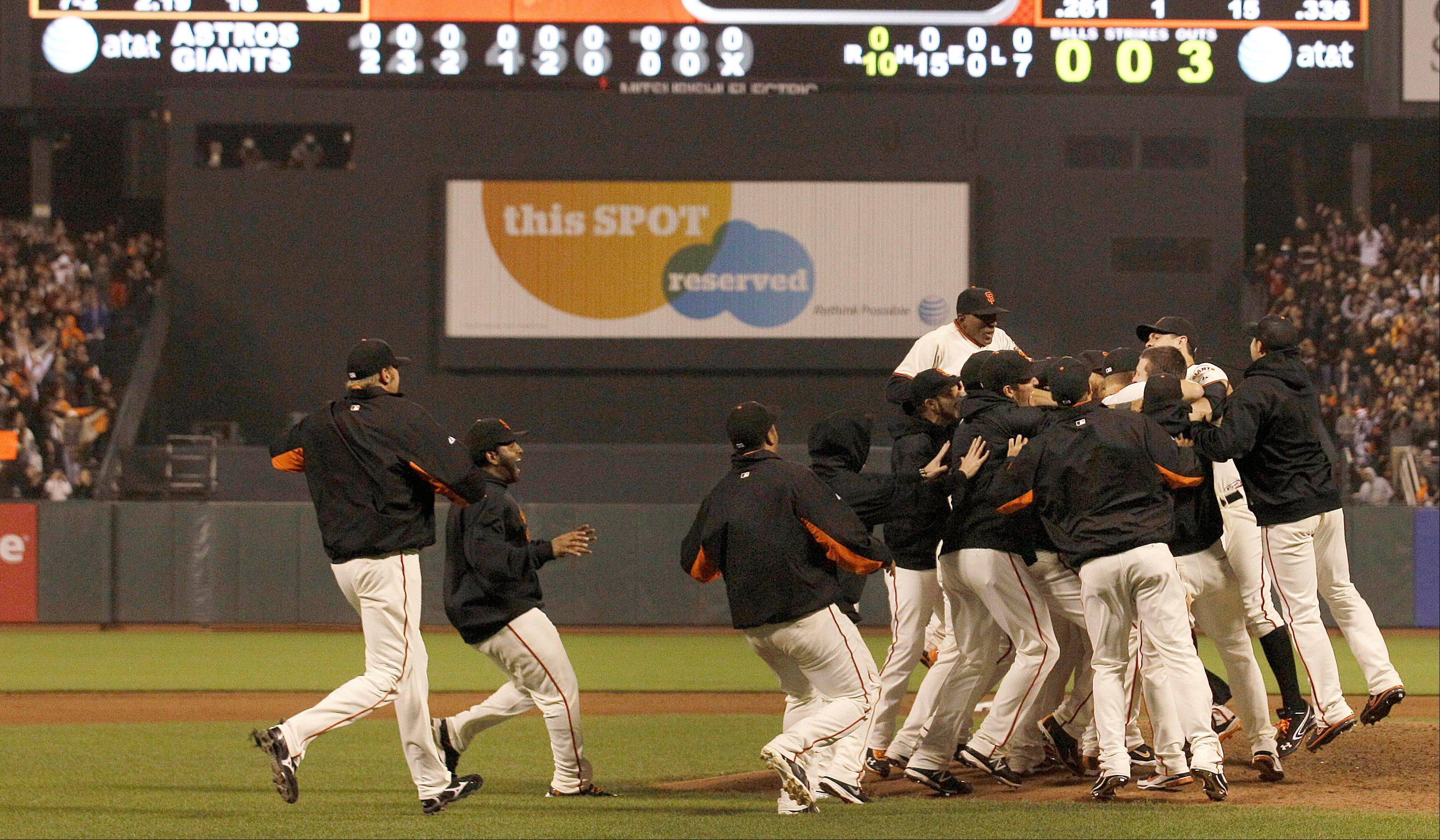 San Francisco Giants players celebrate Wednesday after pitcher Matt Cain pitched a perfect game.