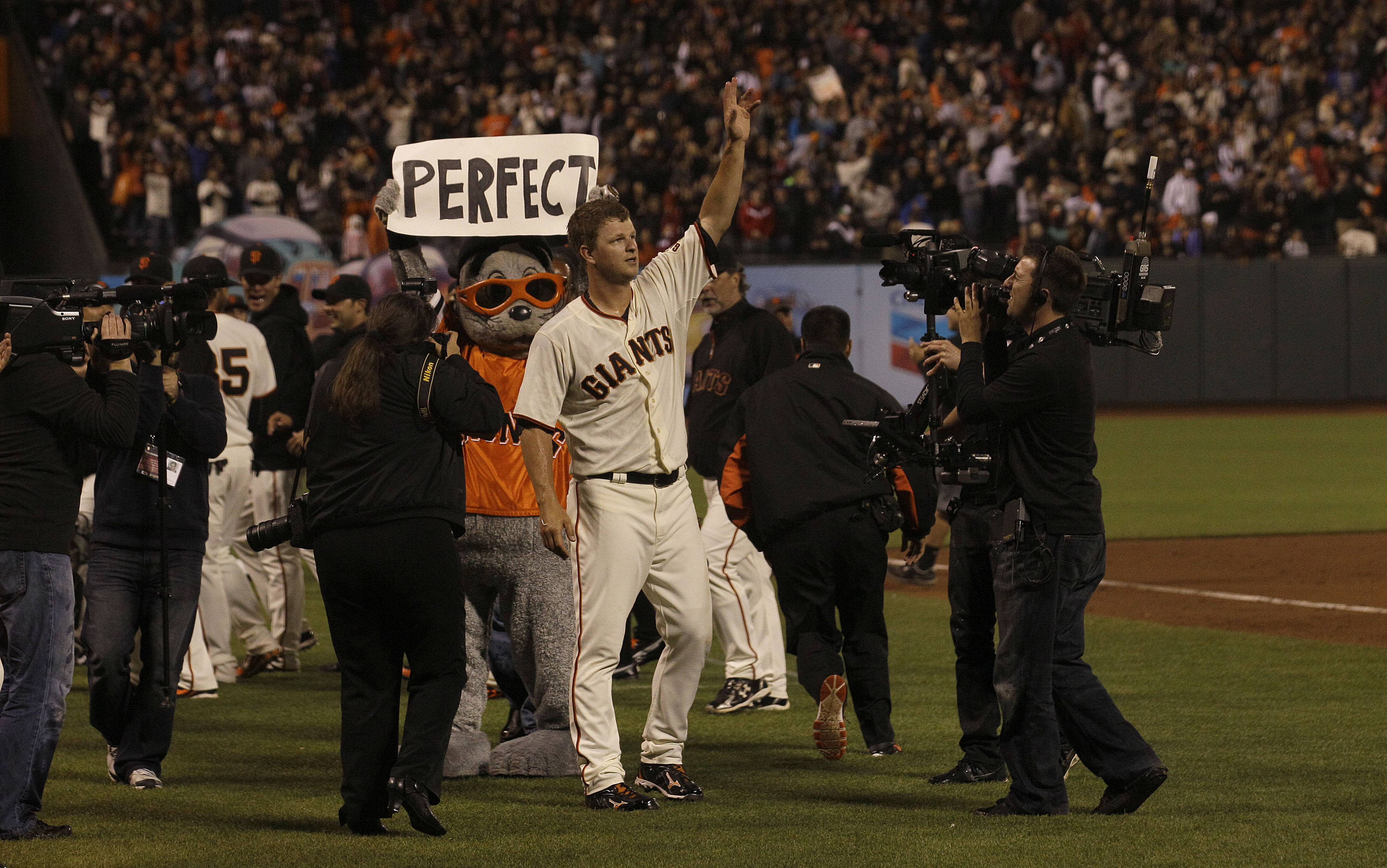 San Francisco Giants pitcher Matt Cain celebrates after his perfect game.