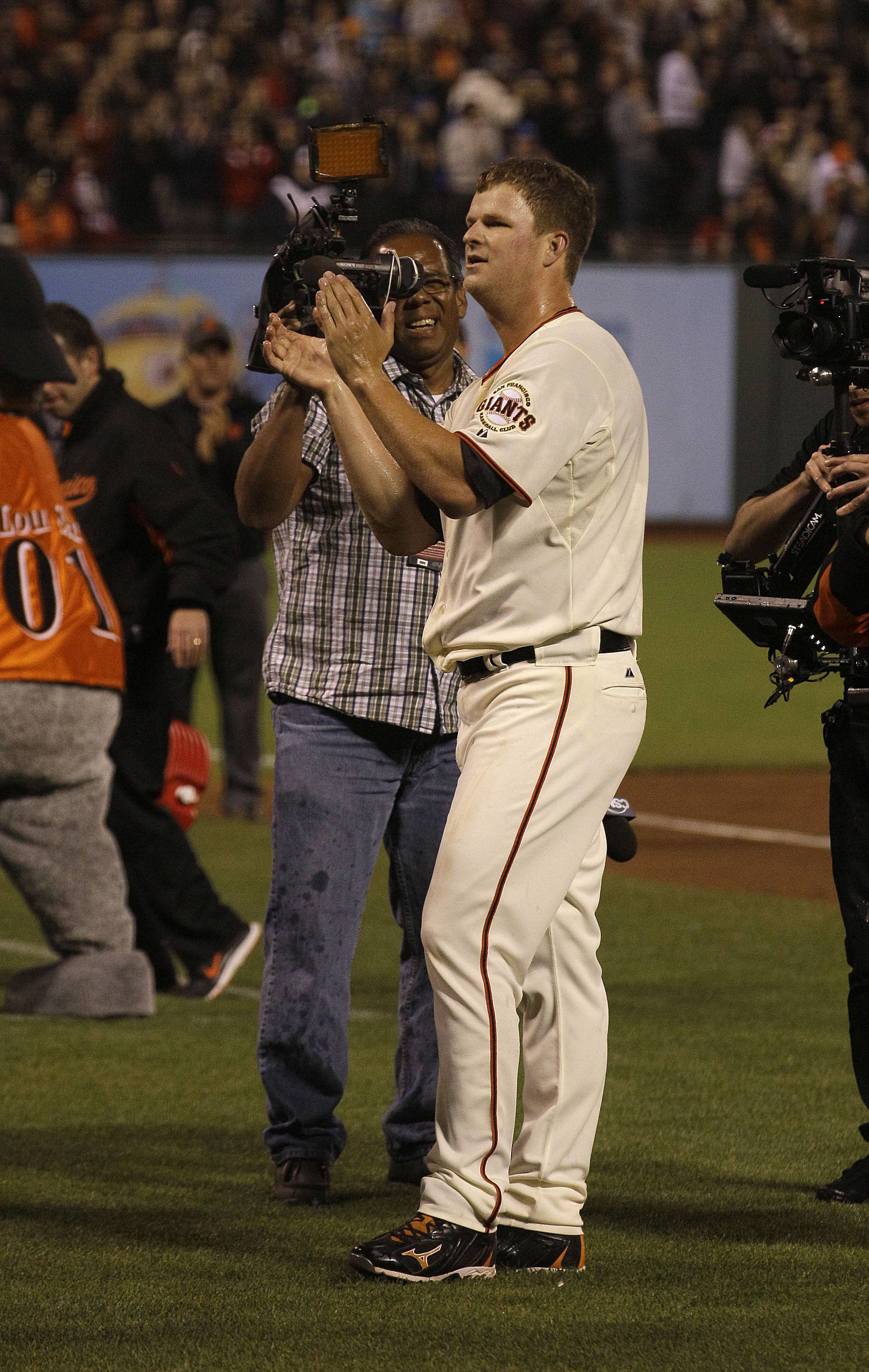 San Francisco Giants pitcher Matt Cain salutes the fans after his perfect game.