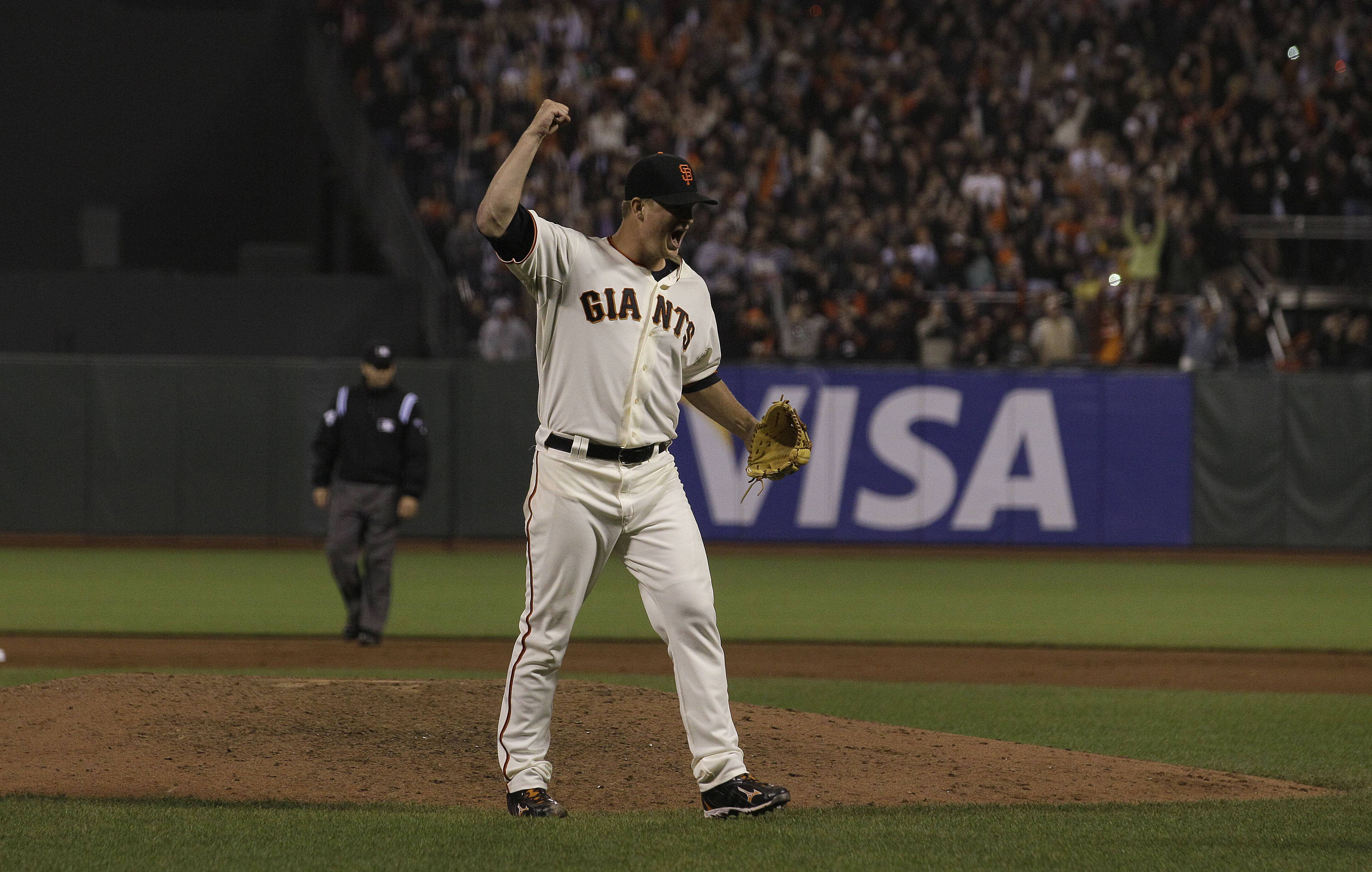 San Francisco Giants pitcher Matt Cain celebrates after recording the final out Wednesday night.