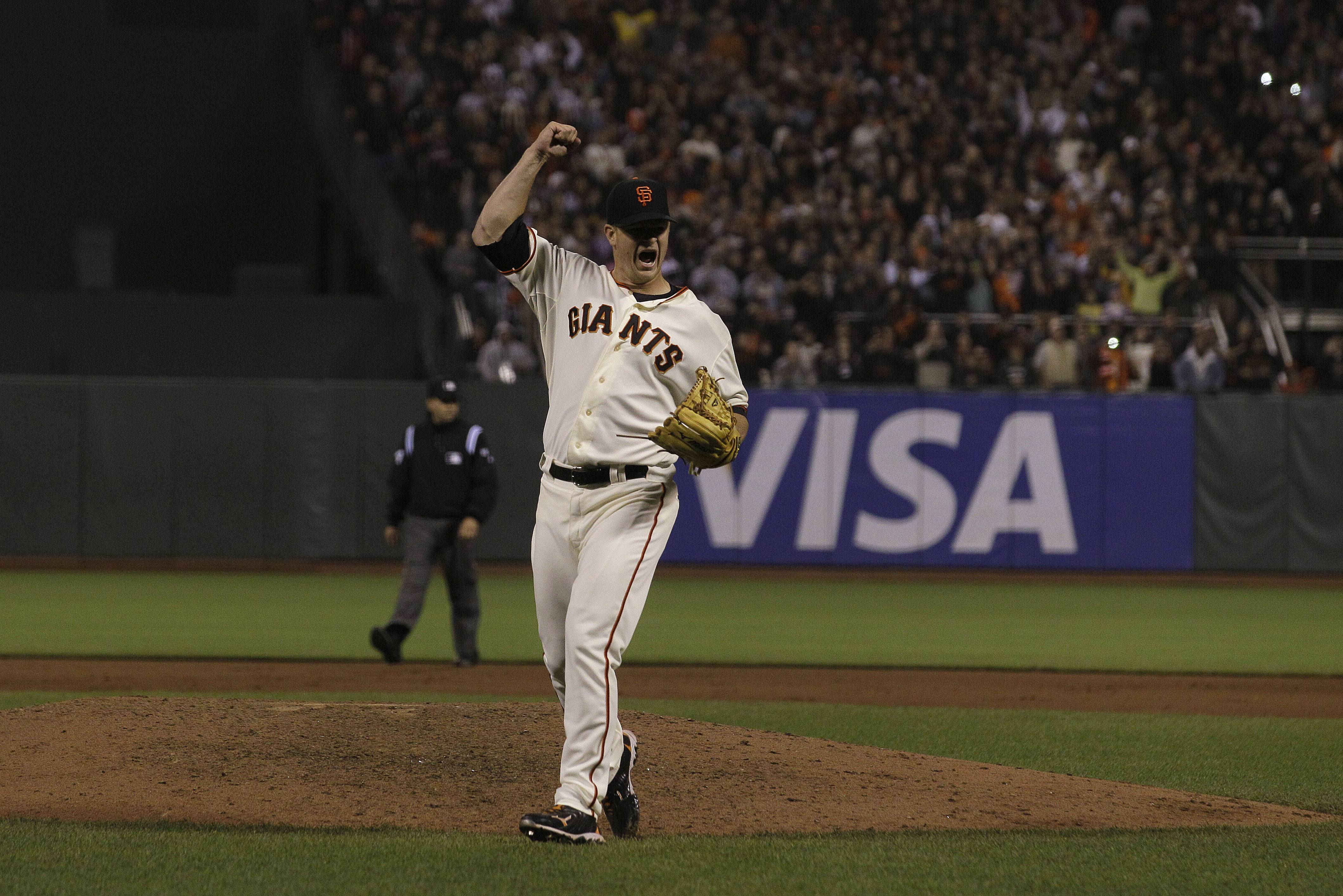 San Francisco Giants pitcher Matt Cain celebrates after his perfect game Wednesday night.