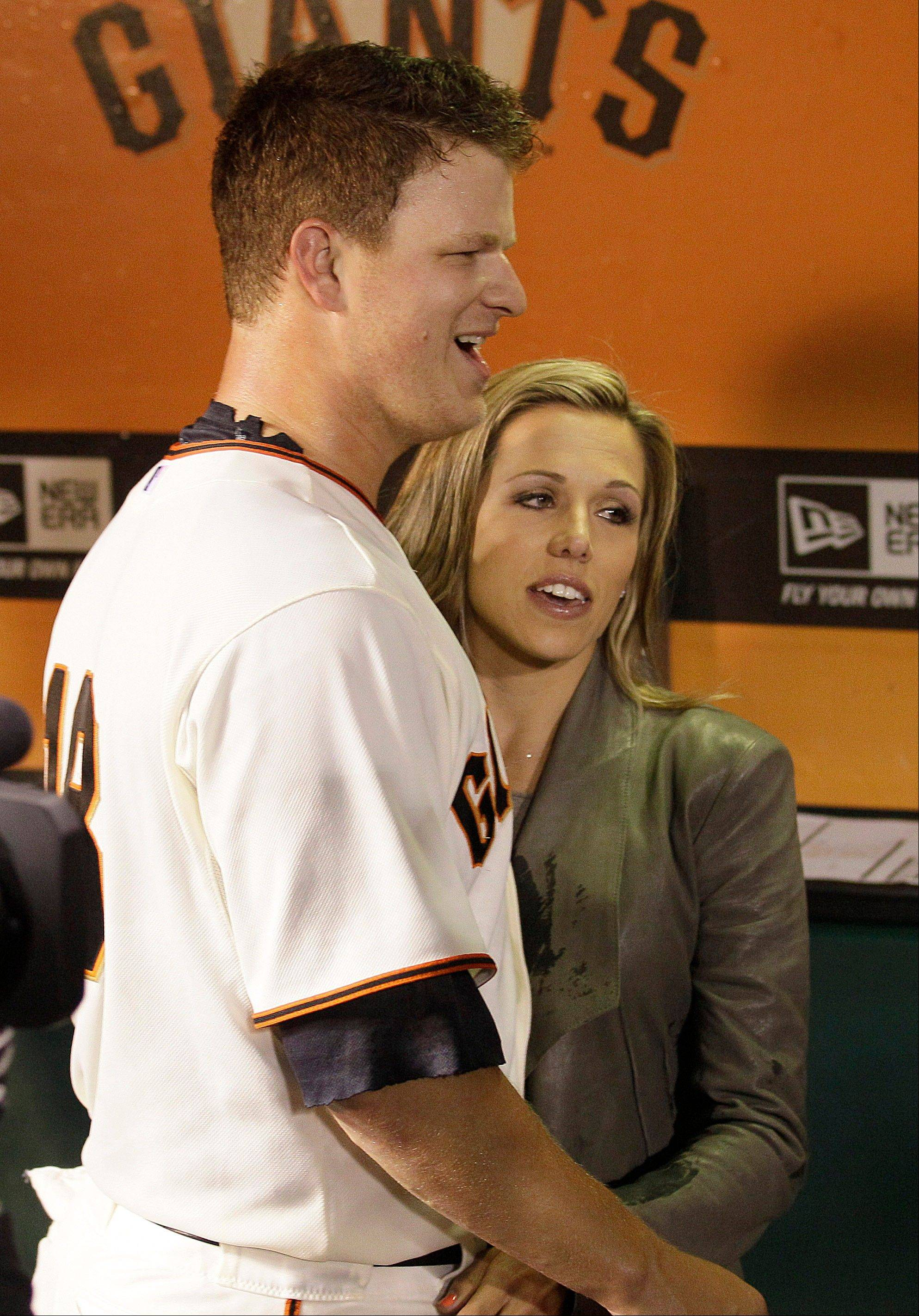 San Francisco Giants pitcher Matt Cain, left, celebrates with his wife, Chelsea, Wednesday after beating the Houston Astros in San Francisco.
