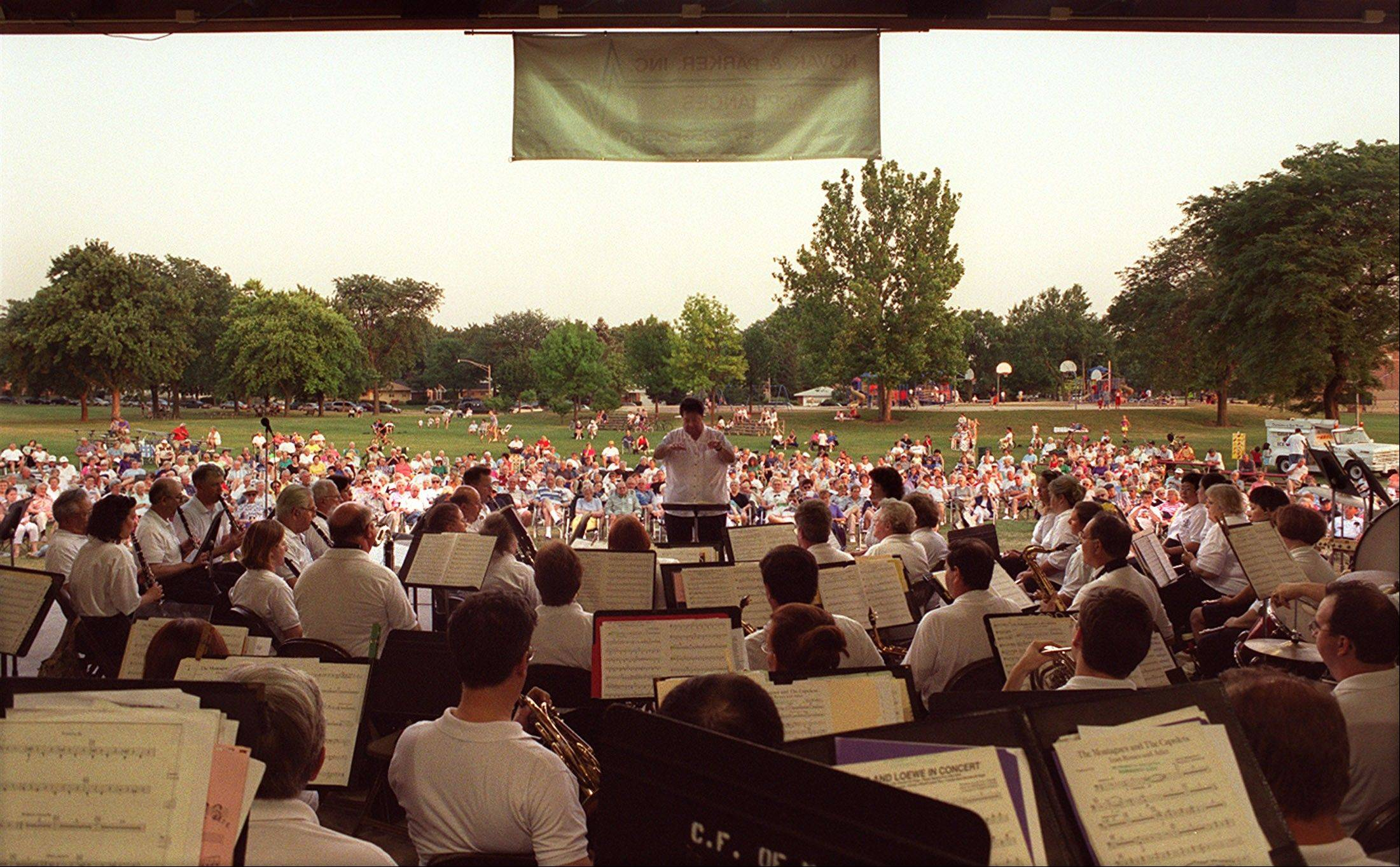 Director Ralph Wilder leads the Mount Prospect Community Band at the Lions Memorial Park Bandshell.