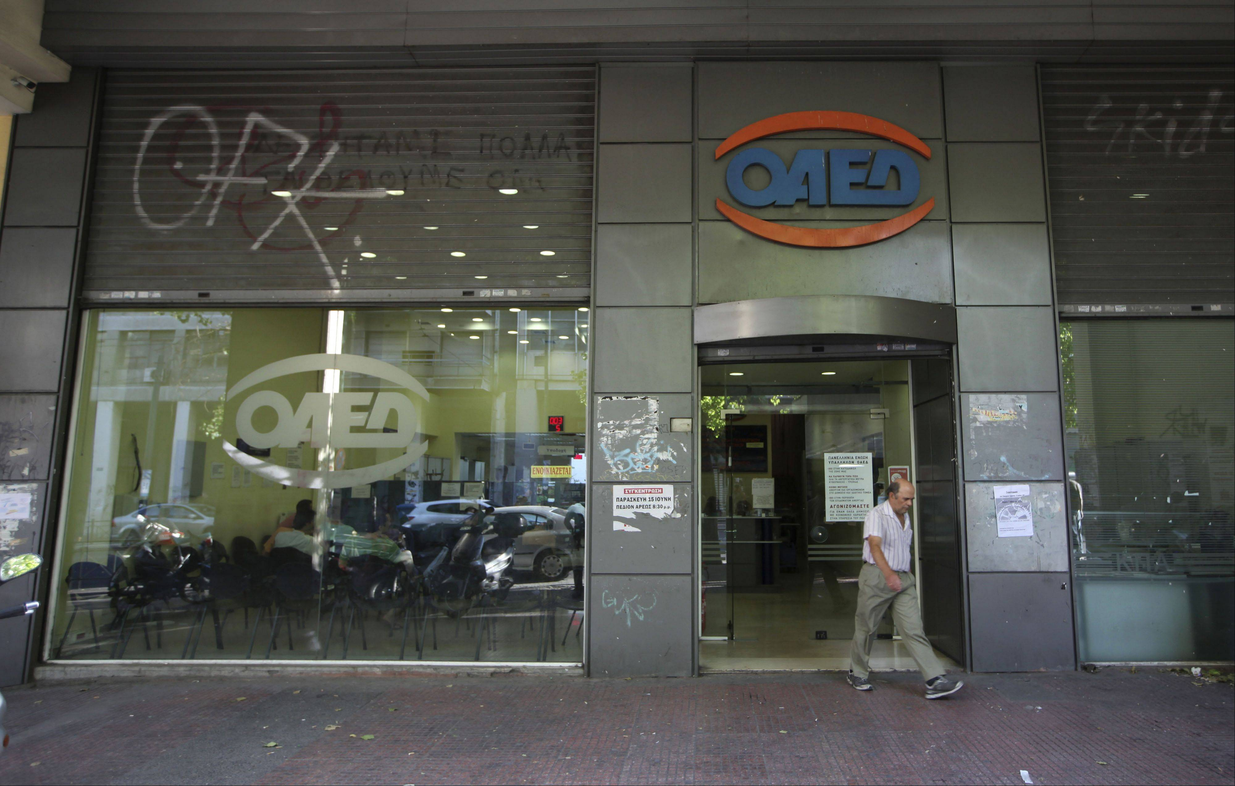 A jobseeker exits an OAED employment center Friday in Athens.