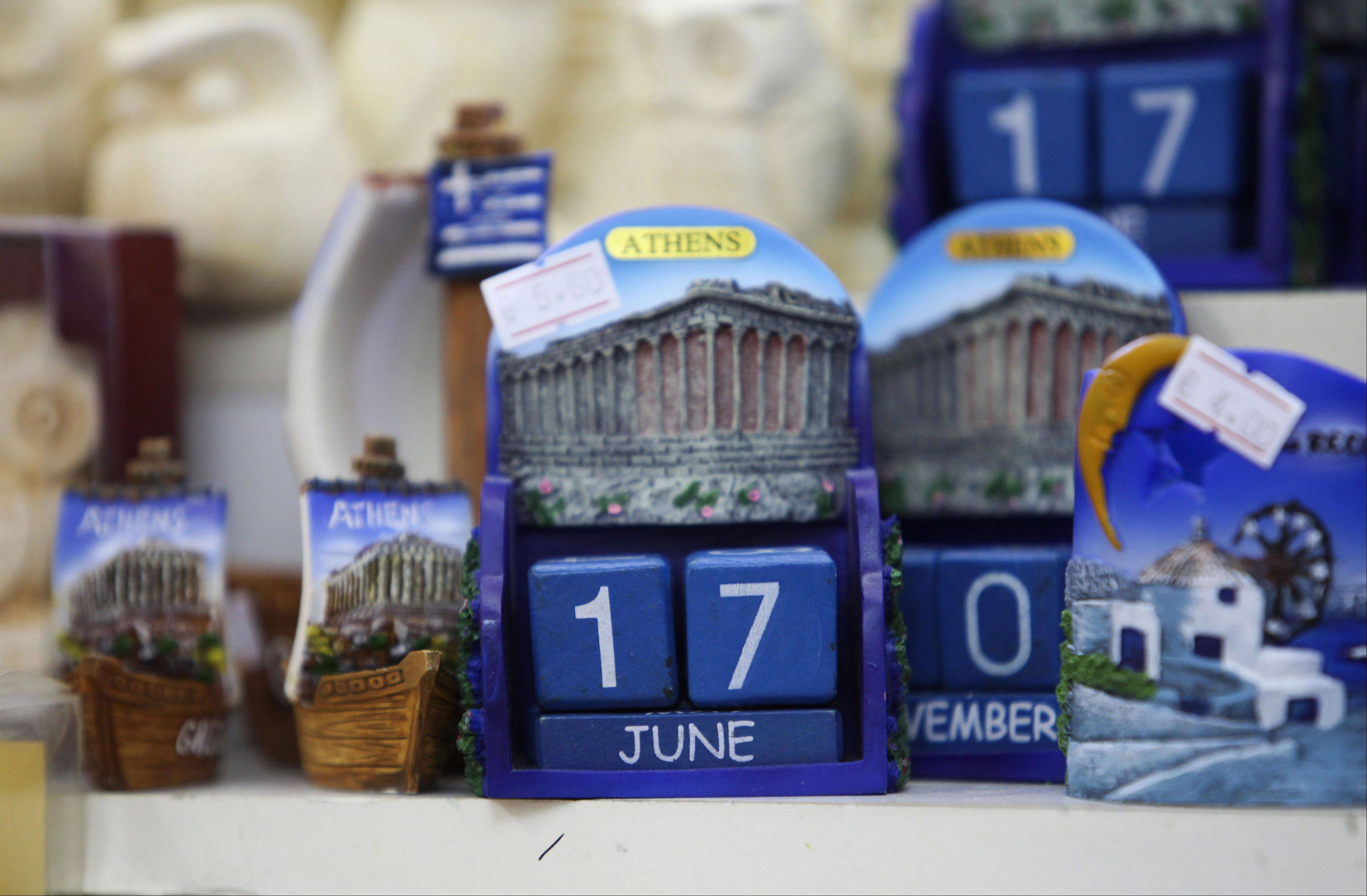 A souvenir calendar displaying the date of the Greek election sits for sale at a tourist store Thursday in Athens, Greece.