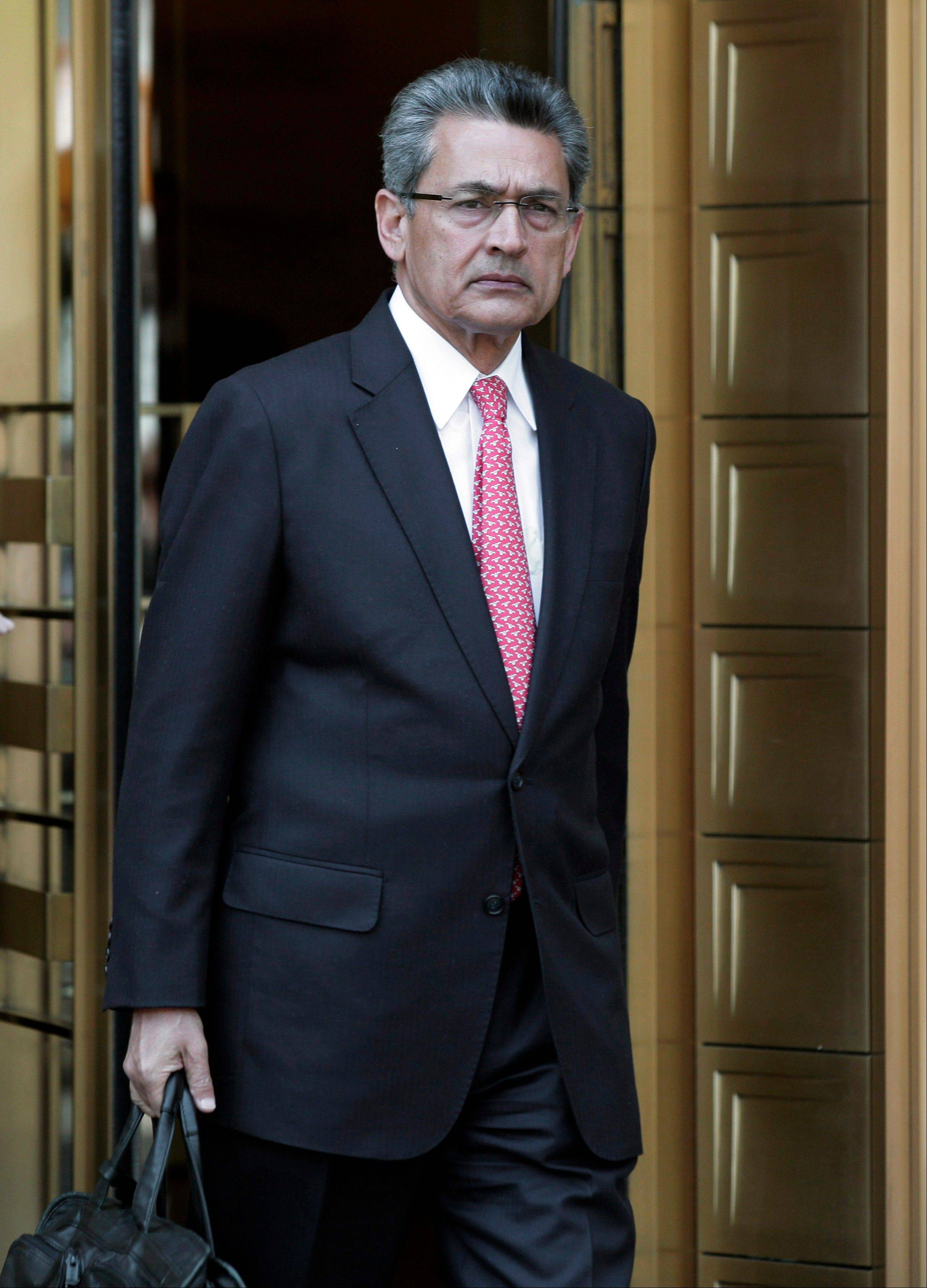 Former Goldman Sachs director Rajat Gupta leaves federal court Friday in New York.