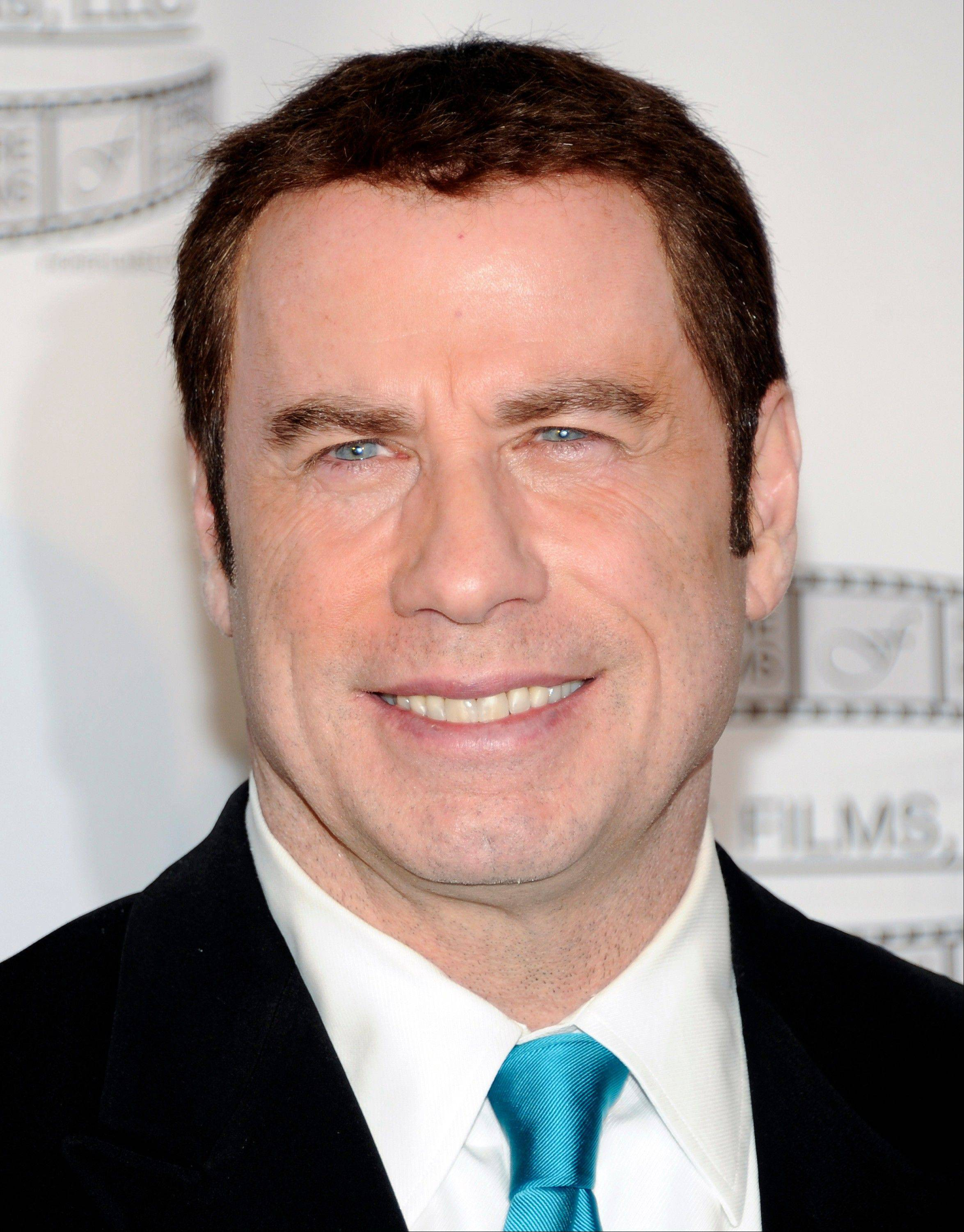Two years after his last film, actor John Travolta returns to the big screen amid a flurry of bad press about his personal life.
