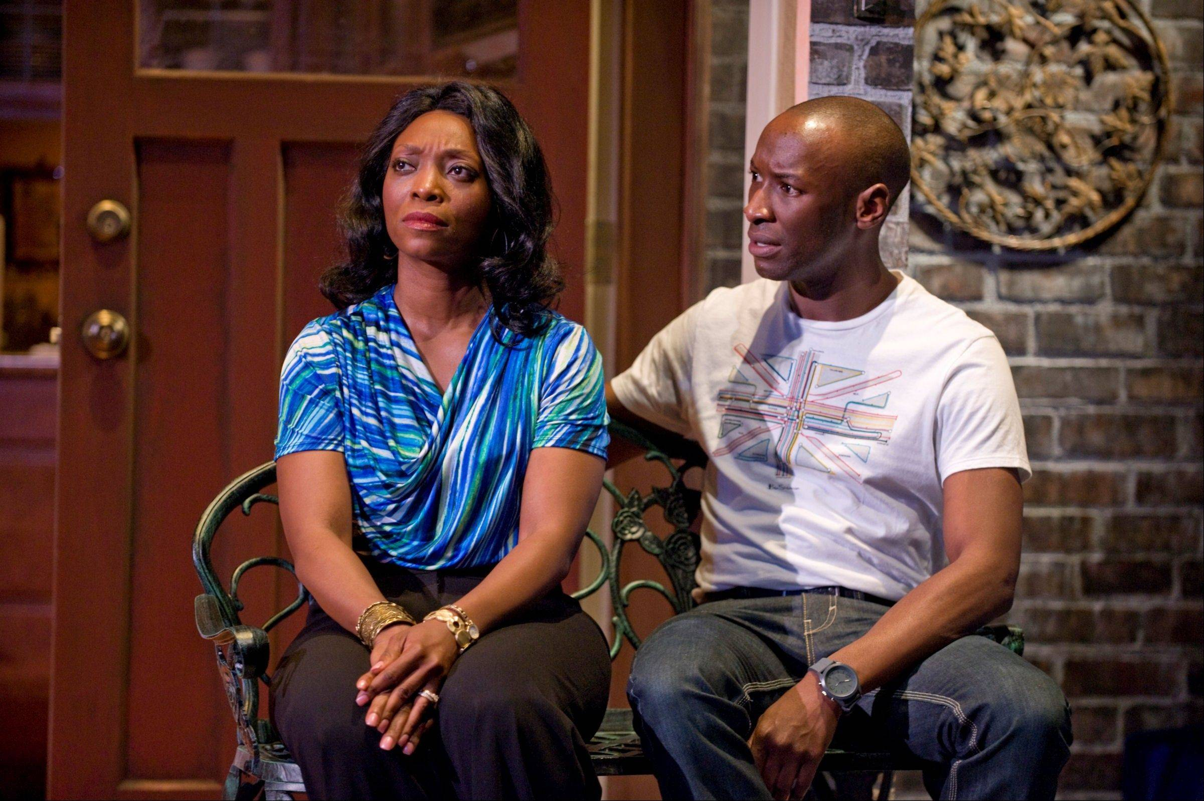 "Sister and brother Evy Bryant Jerome (Shan�sia Davis) and Jesse Bryant (Phillip James Brannon) reflect on their childhood together in Paul Oakley Stovall's comic drama ""Immediate Family"" at the Goodman Theatre in Chicago."