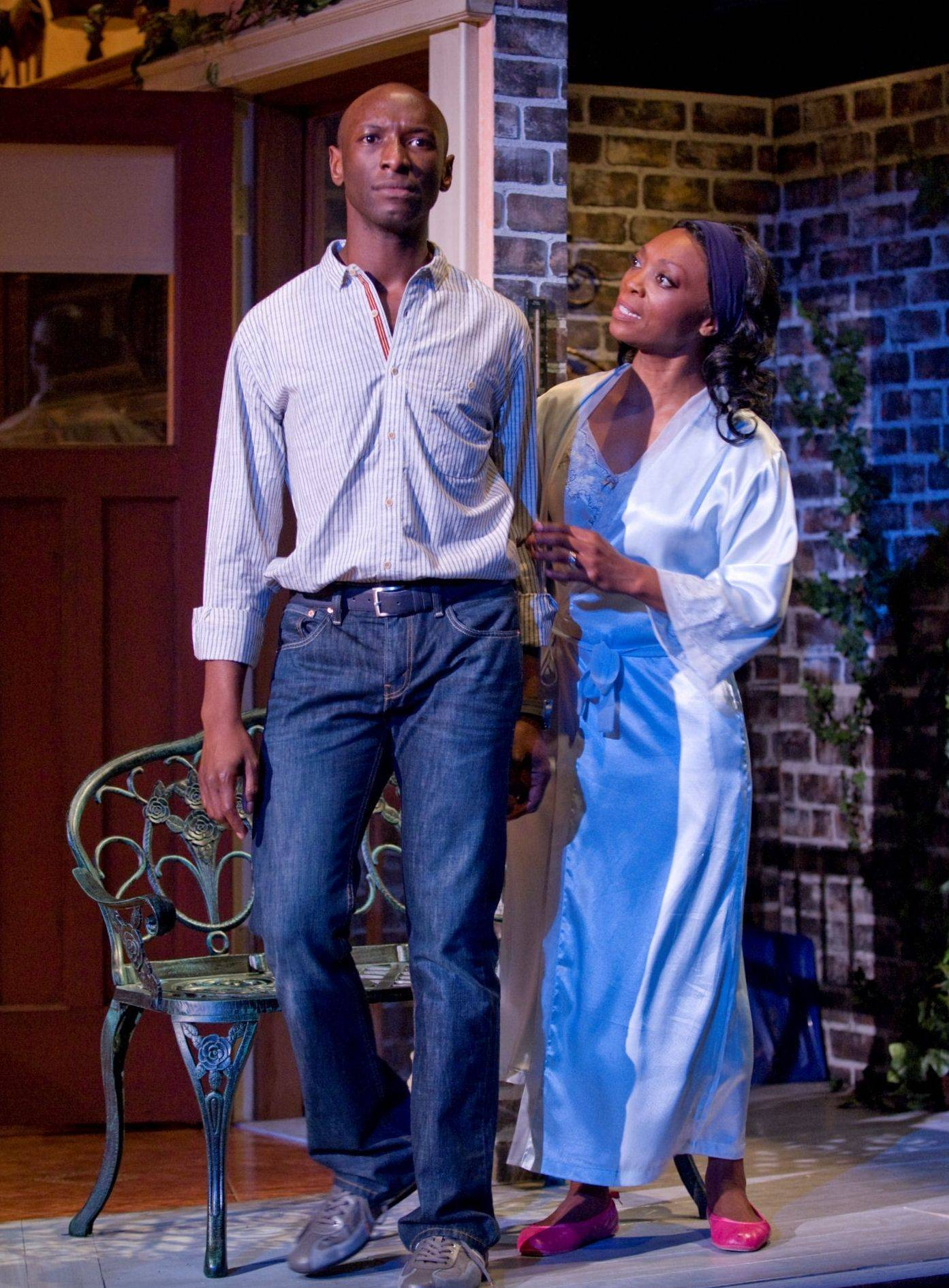"Brother and sister Jesse Bryant (Phillip James Brannon) and Evy Bryant Jerome (Shanèsia Davis) get into a biblical argument about his sexuality in Paul Oakley Stovall's comic drama ""Immediate Family"" at the Goodman Theatre in Chicago."