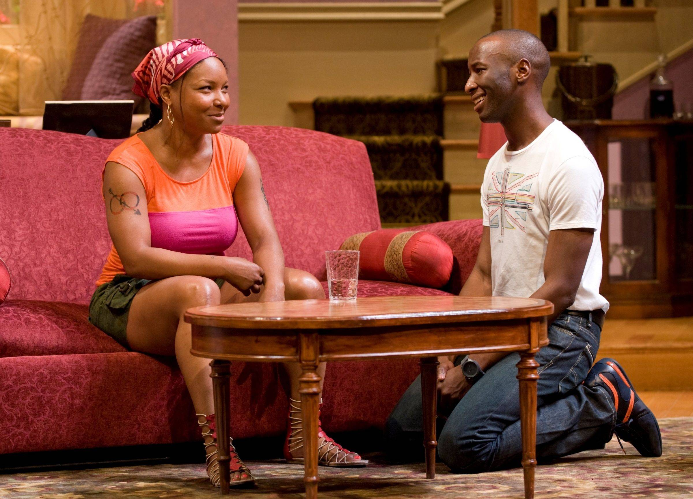 "Childhood friends Nina Cole (J. Nicole Brooks) and Jesse Bryant (Phillip James Brannon) reunite in the comic drama ""Immediate Family"" at the Goodman Theatre in Chicago."