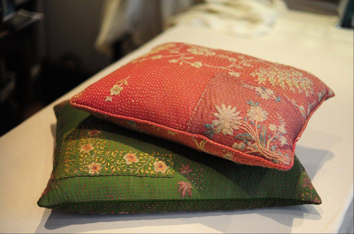 Cushions, made of fabric inspired by Carlisle's travel to India, are sold at Bergdorf Goodman.