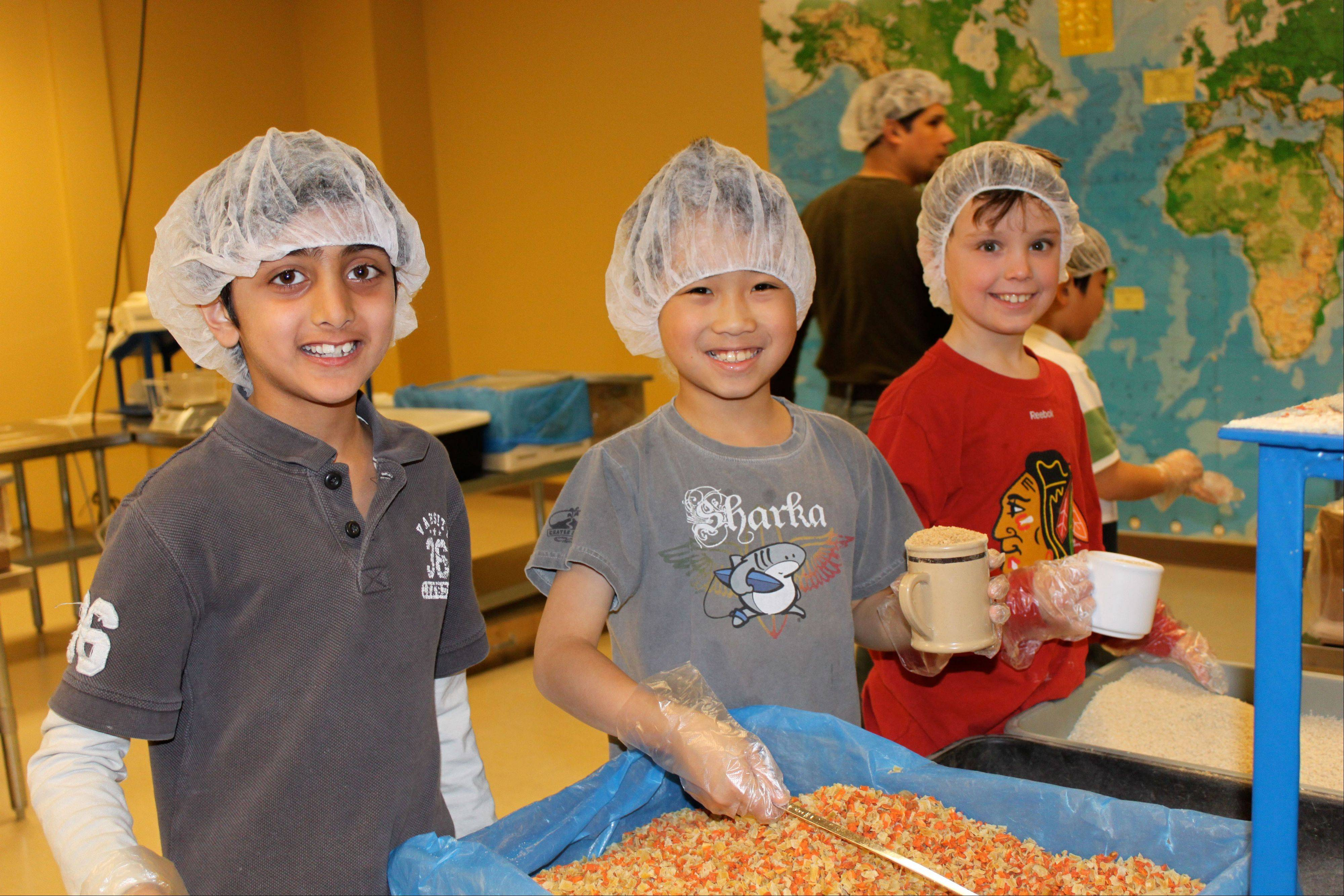 Kids as young as 5 are welcome to join the fun packing sessions at Feed My Starving Children.