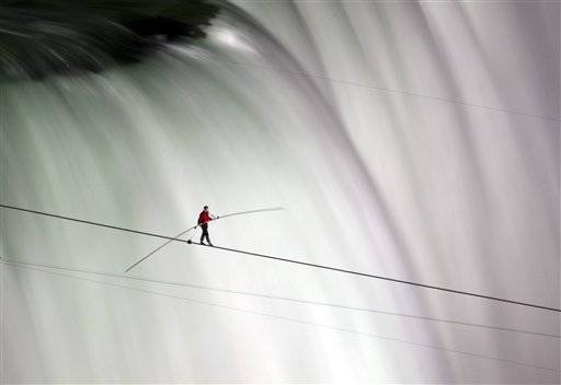 Daredevil Nik Wallenda has finished his attempt to become the first person to walk on a tightrope 1,800 Nik Wallenda walks over Niagara Falls on a tightrope in Niagara Falls, Ontario, on Friday, June 15, 2012. Wallenda has finished his attempt to become the first person to walk on a tightrope 1,800 feet across the mist-fogged brink of roaring Niagara Falls. The seventh-generation member of the famed Flying Wallendas had long dreamed of pulling off the stunt, never before attempted.