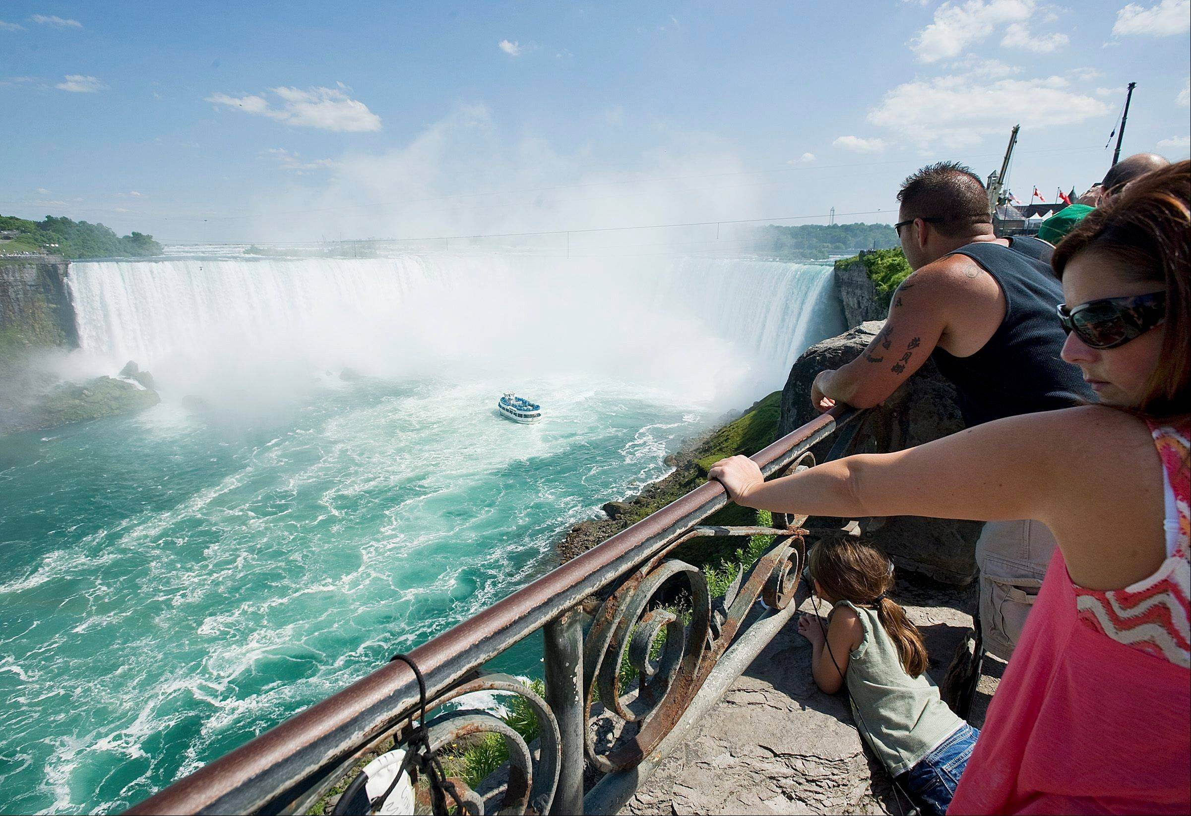 A family looks as the Maid of the Mist turns around at Niagara Falls, where Nik Wallenda will walk a 550 metre-long tightrope in Niagara Falls, Ont., on Friday, June 15, 2012.