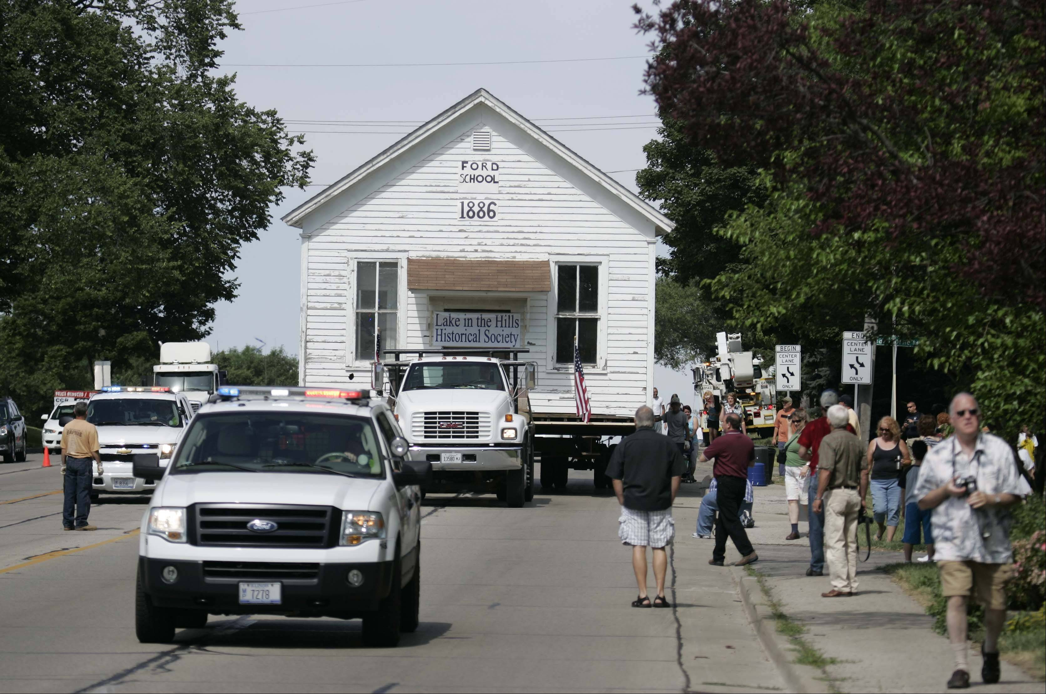 The Lake in the Hills Historical Society with a lot of help from Lyle Hyatt & Co. Inc., of Sandwich, moves the 1886 Ford schoolhouse back to its original location, where it will be turned into a museum.