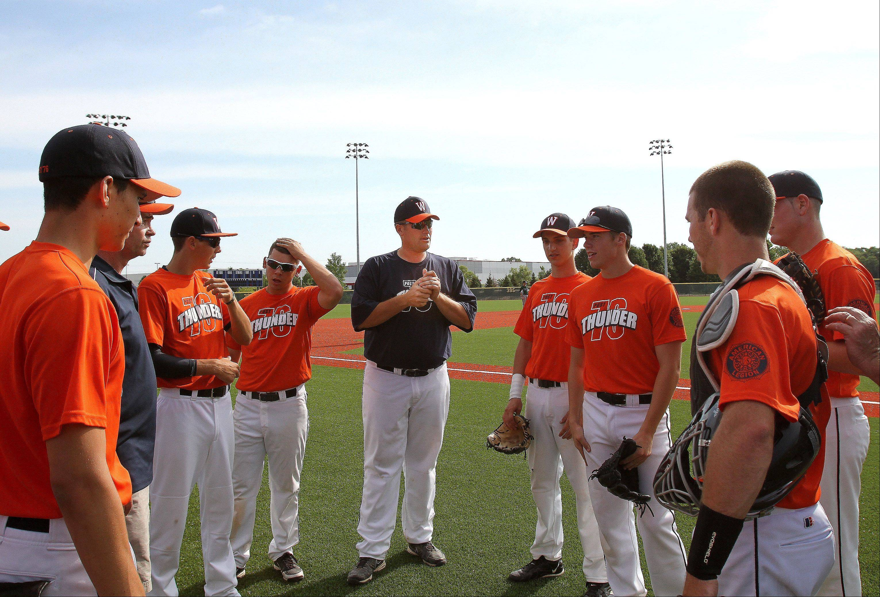 Jerry Miller, center, coach of the Post 76 Thunder, meets with his team Friday on opening day of the Legion Post 76 Summer Classic Tournament in Carol Stream. The tourney, which runs through Sunday, features 20 teams from four Midwestern states.