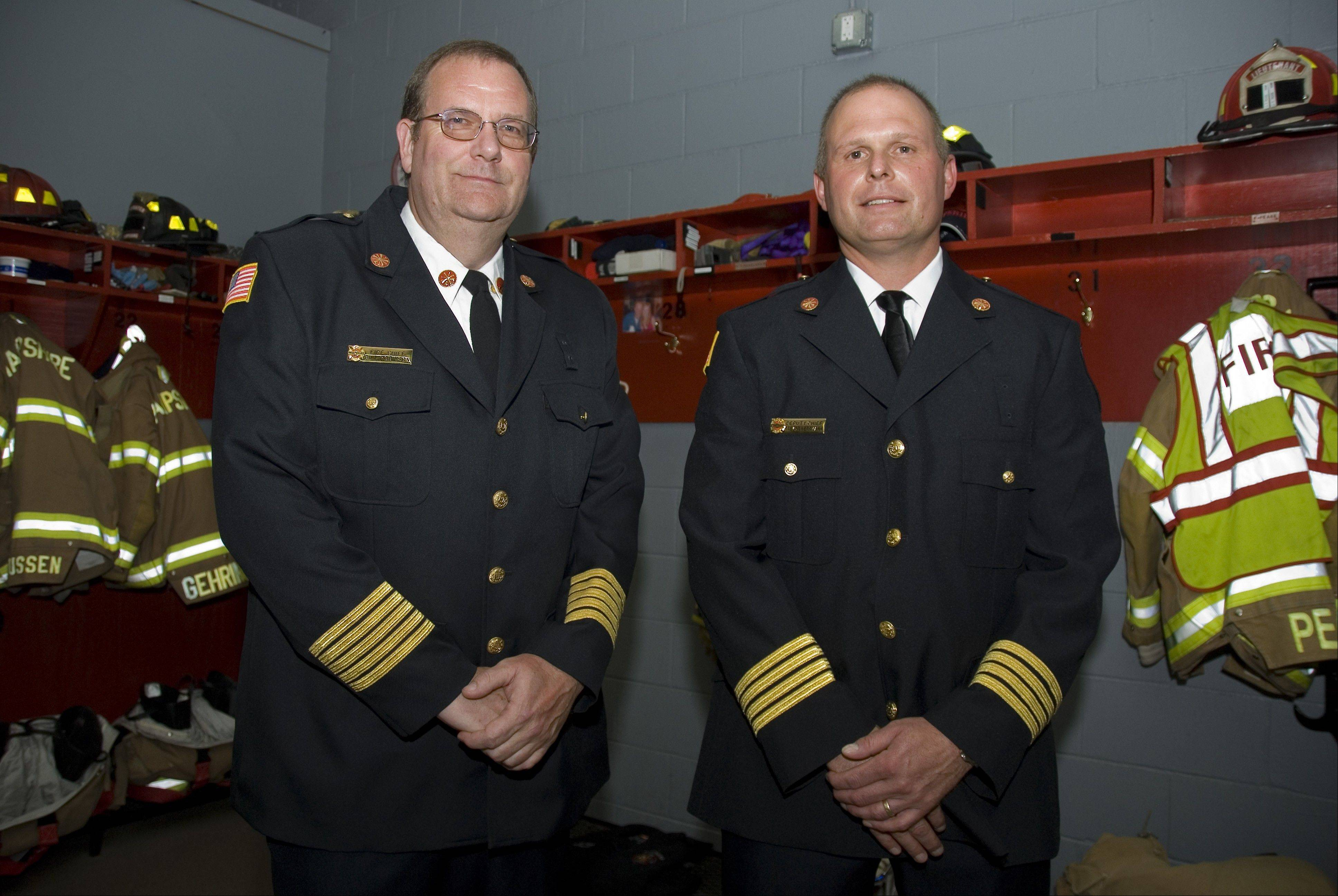 Bill Robinson, left, is the new chief and Trevor Herrmann is the new deputy chief of the Hampshire Fire Protection District. Both men were sworn in this week.