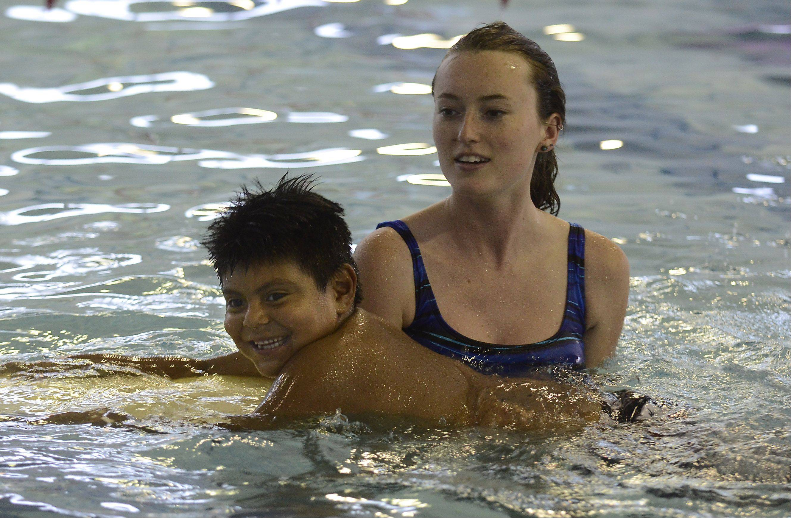 Nieve Heslan works with Luis Reyes, 6, at the first day of camp at the Wheeling Park District.