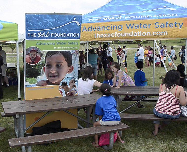 A photo of Zachary Cohn is on the poster for the ZAC Foundation at the water safety camp in Wheeling.