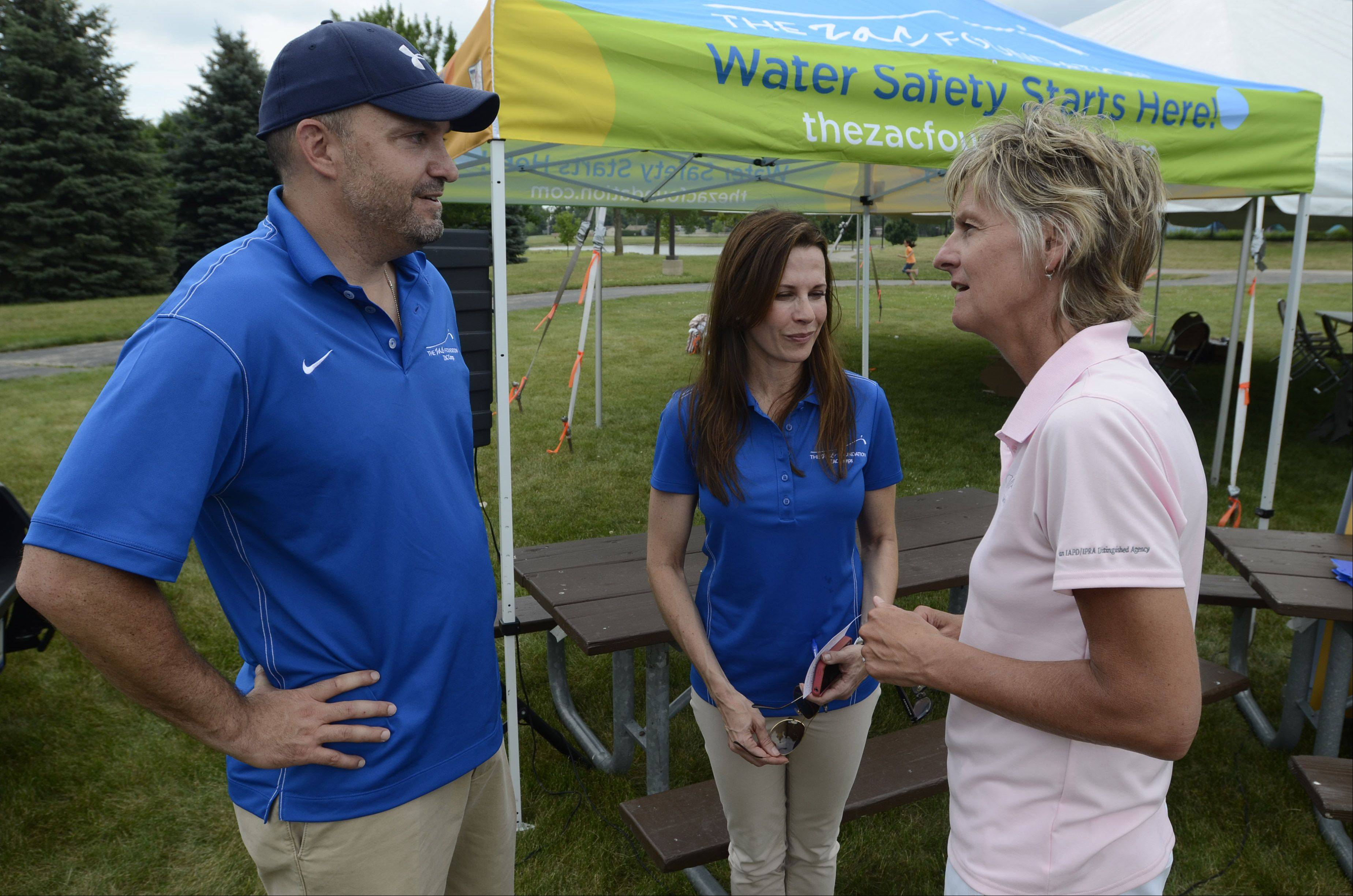 Brian and Karen Cohn talk with Wheeling Park District Director Jan Buchs at the opening day of swim camp.