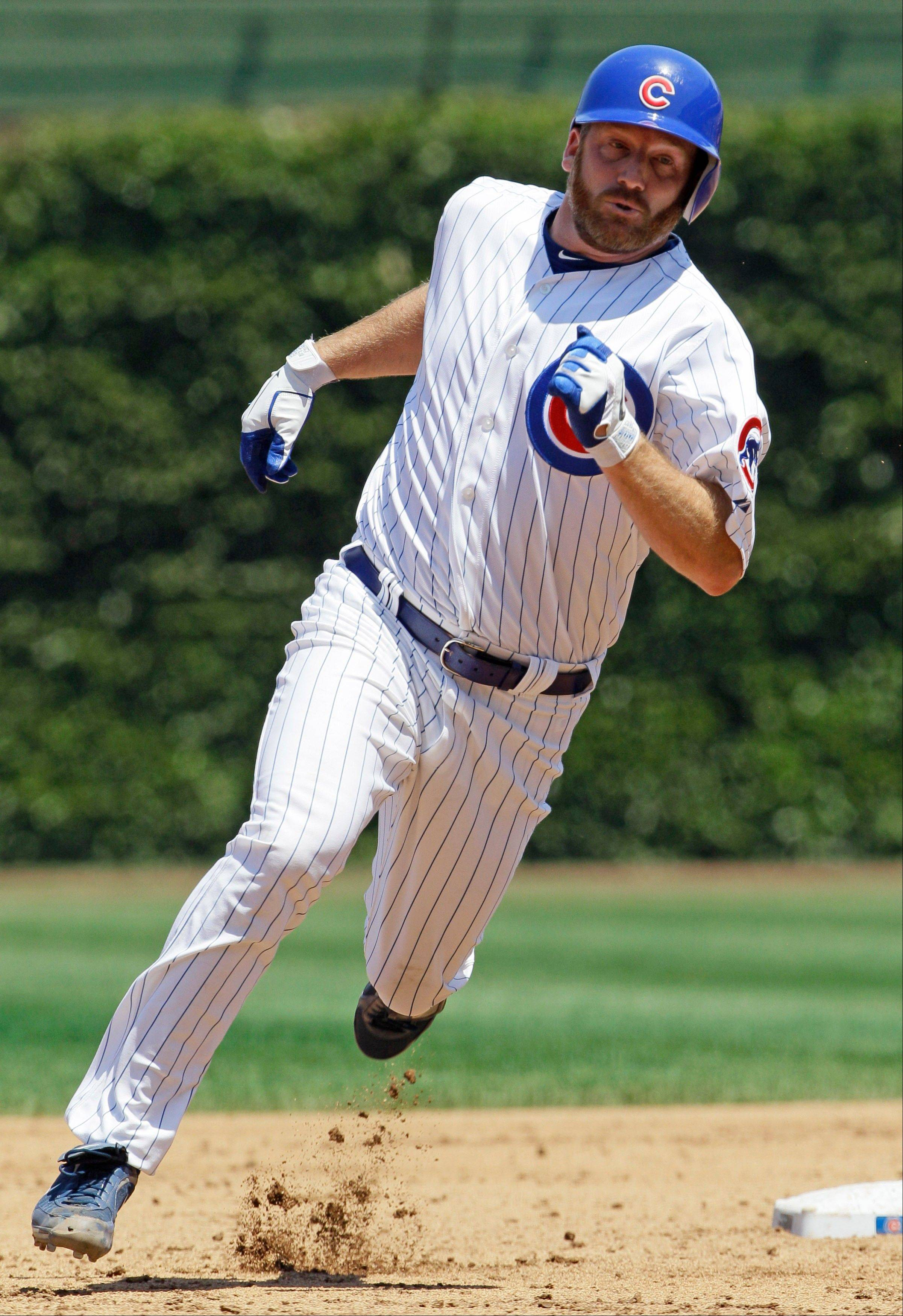 Cubs starter Ryan Dempster runs toward third base while legging out a triple in the second inning against the Red Sox on Friday at Wrigley Field.