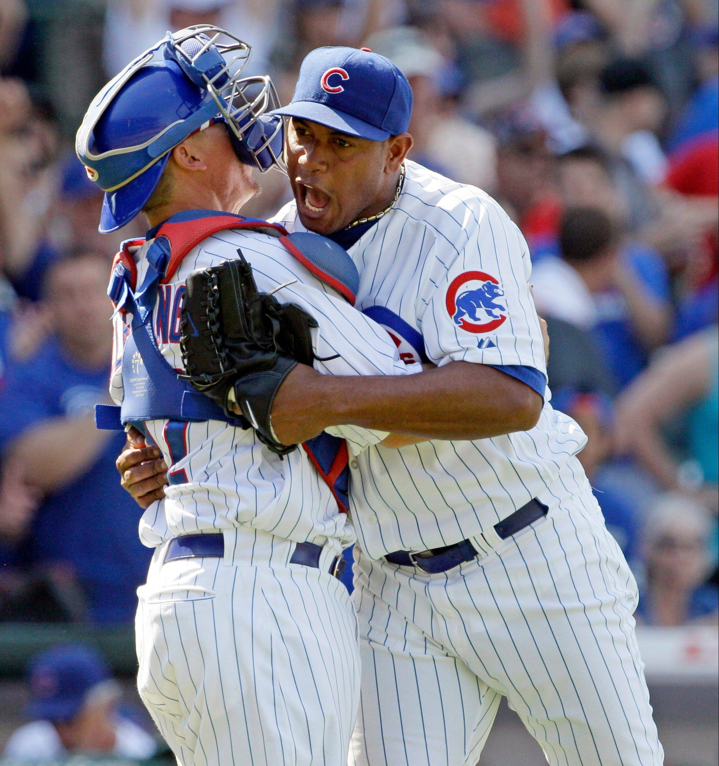 Carlos Marmol celebrates with catcher Steve Clevenger after saving the Cubs' 3-0 victory over the Red Sox at Wrigley Field. Marmol, who lost his job as closer before going on the disabled list, earned his third save of the season and first since May 2.