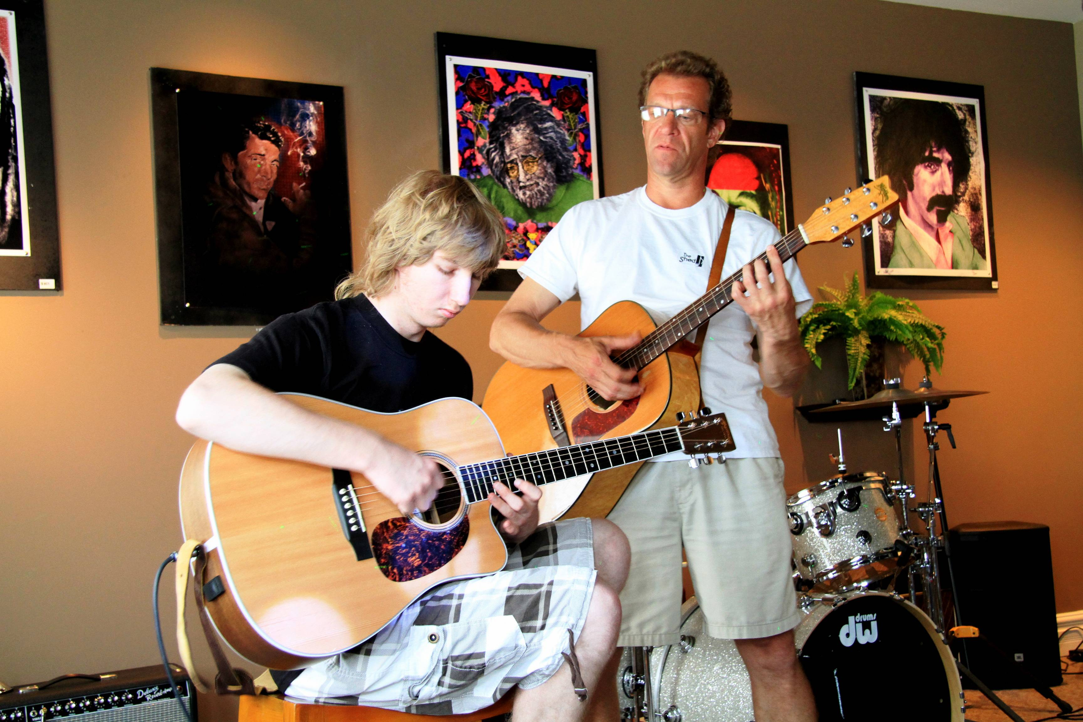 Nikolay Stepin, 18, of Buffalo Grove practices under the watchful eye of instructor Brad Nye during Rock N Roll Summer Camp at The Shed in Highland Park. Registration for Session 2 running July 9-20 is now being accepted. Call (847) 780-4944.
