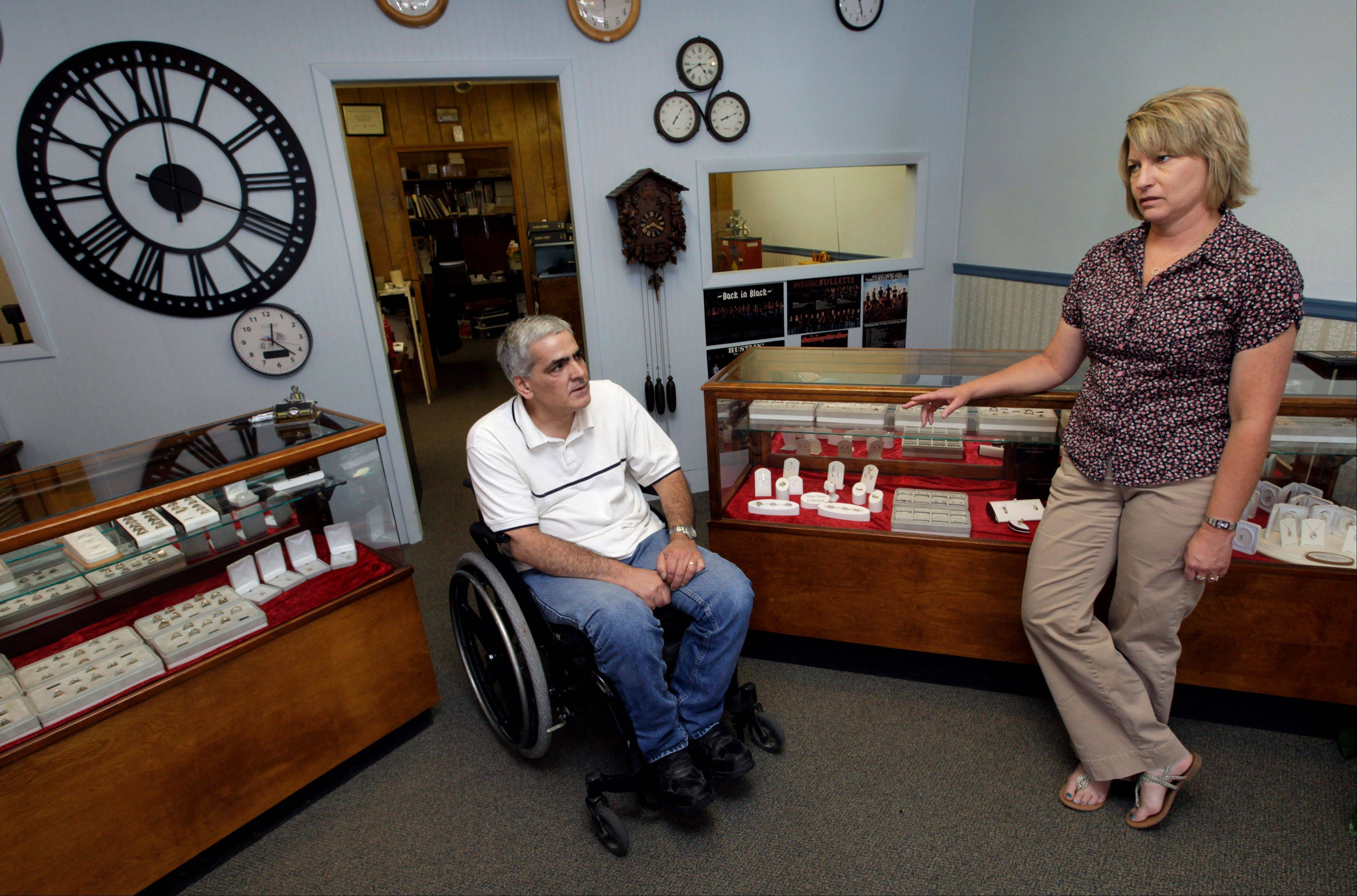Mike Lamm talks with his wife Tracey in the showroom of his jewelry shop in Mediapolis, Iowa.