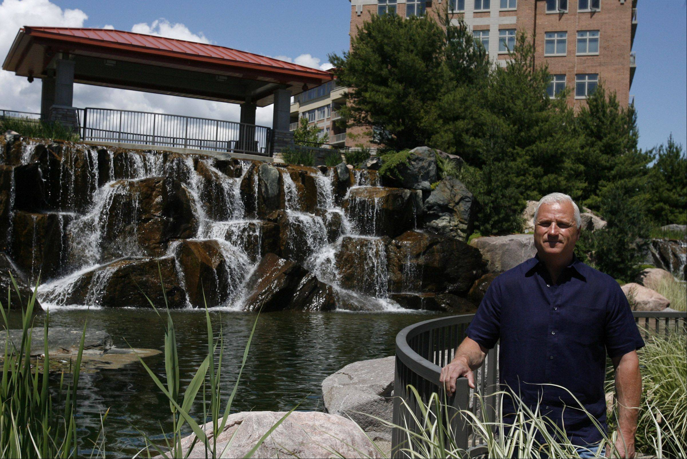 Mark Smith said an aquifer on a once swampy piece of land now feeds the waterfall at Prairie Park Condominiums in Wheeling.