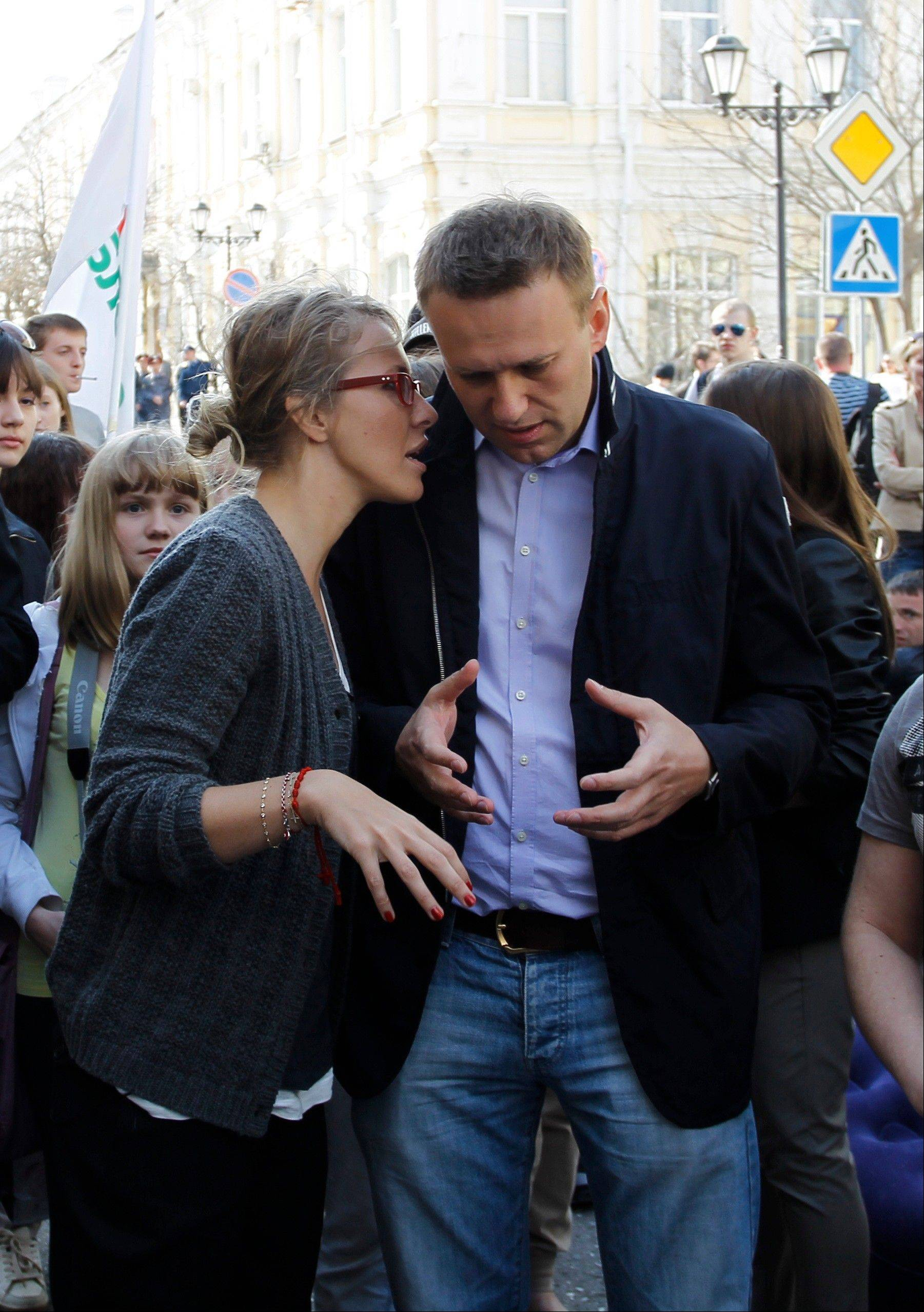 "Russian socialite and TV host Kseniya Sobchak, daughter of the late St. Petersburg mayor, Anatoly Sobchak, left, speaks to anti-corruption campaigner Alexei Navalny during a rally in the southern Russian city of Astrakhan on April 14. ""I'm Ksenia Sobchak, and I've got something to lose. But I'm here."" This is what the 30-year-old blond socialite and TV personality said when she began her unlikely foray into political activism by taking the stage at a huge anti-Putin rally in December. Once considered untouchable because of her family's close personal ties to President Vladimir Putin, Sobchak has since found that she does indeed have something to lose, as her apartment has been raided by police and she has been called in for interrogation. It has been a quick change of fortune for Russia's ""It Girl,"" who like many Russians of her generation experienced a civic awakening after many years of political passivity."