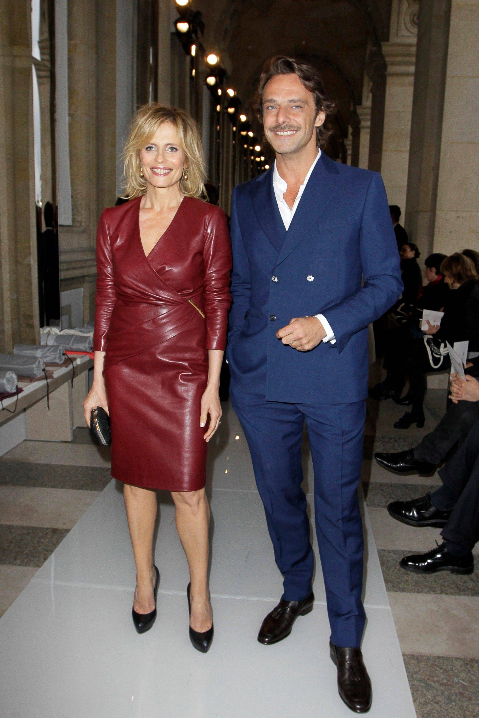 Italian actors Isabella Ferrari, left, and Alessandro Preziosi arrive for the Salvatore Ferragamo Cruise 2013 fashion show at Louvre Museum in Paris, on Tuesday.