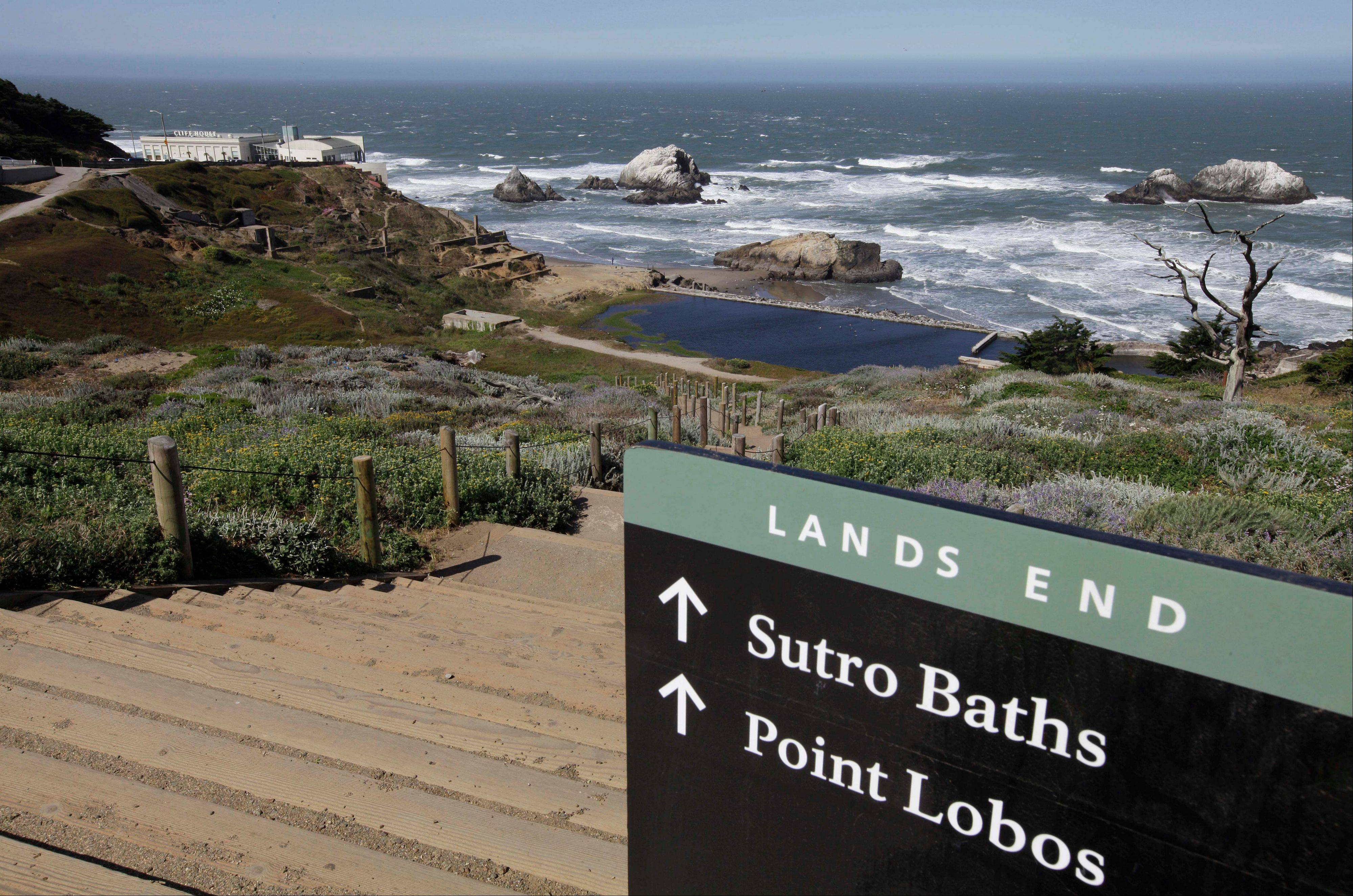 A sign leads down the path to the ruins of the Sutro Baths at Land's End.