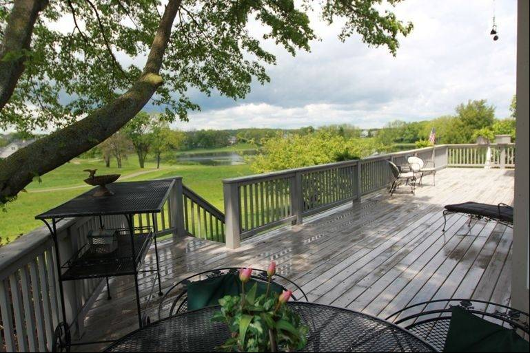 Out back, a large deck overlooks the yard and nearby Chalet Hills Golf Course.