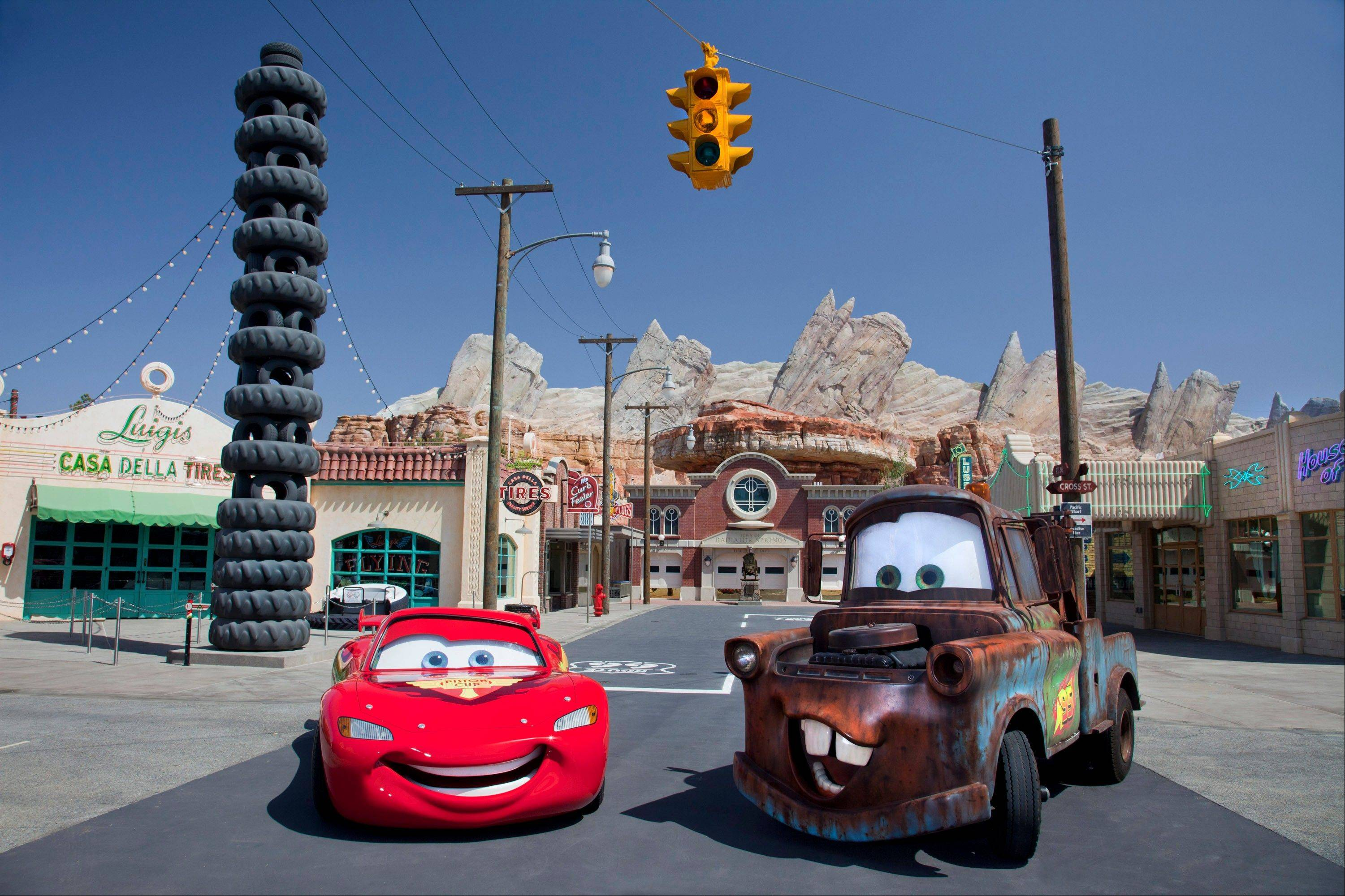 "Characters Lightning McQueen, left, and Mater at the new 12-acre Cars Land, a replica of Radiator Springs, the town in the popular ""Cars,"" film franchise at the Disney California Adventure park at Disneyland Resort in Anaheim, Calif."