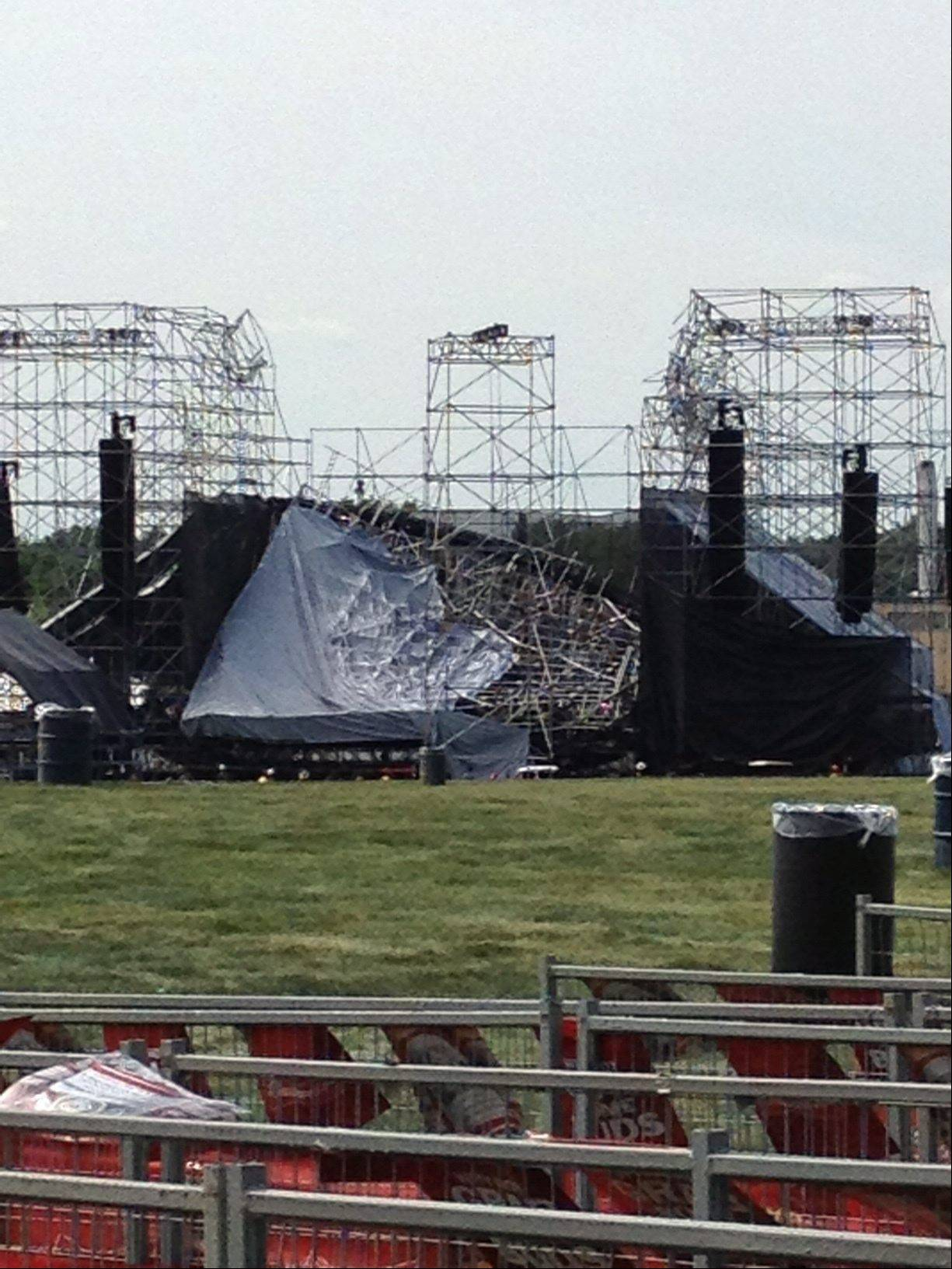This photo provided by Alexandra Mihan shows a collapsed stage at the site for a Radiohead concert at Downsview Park in Toronto on Saturday June 16, 2012. Toronto paramedics say one person is dead and another is seriously hurt after the stage collapsed while setting up for a Radiohead concert. They say two other people were injured and are being assessed.