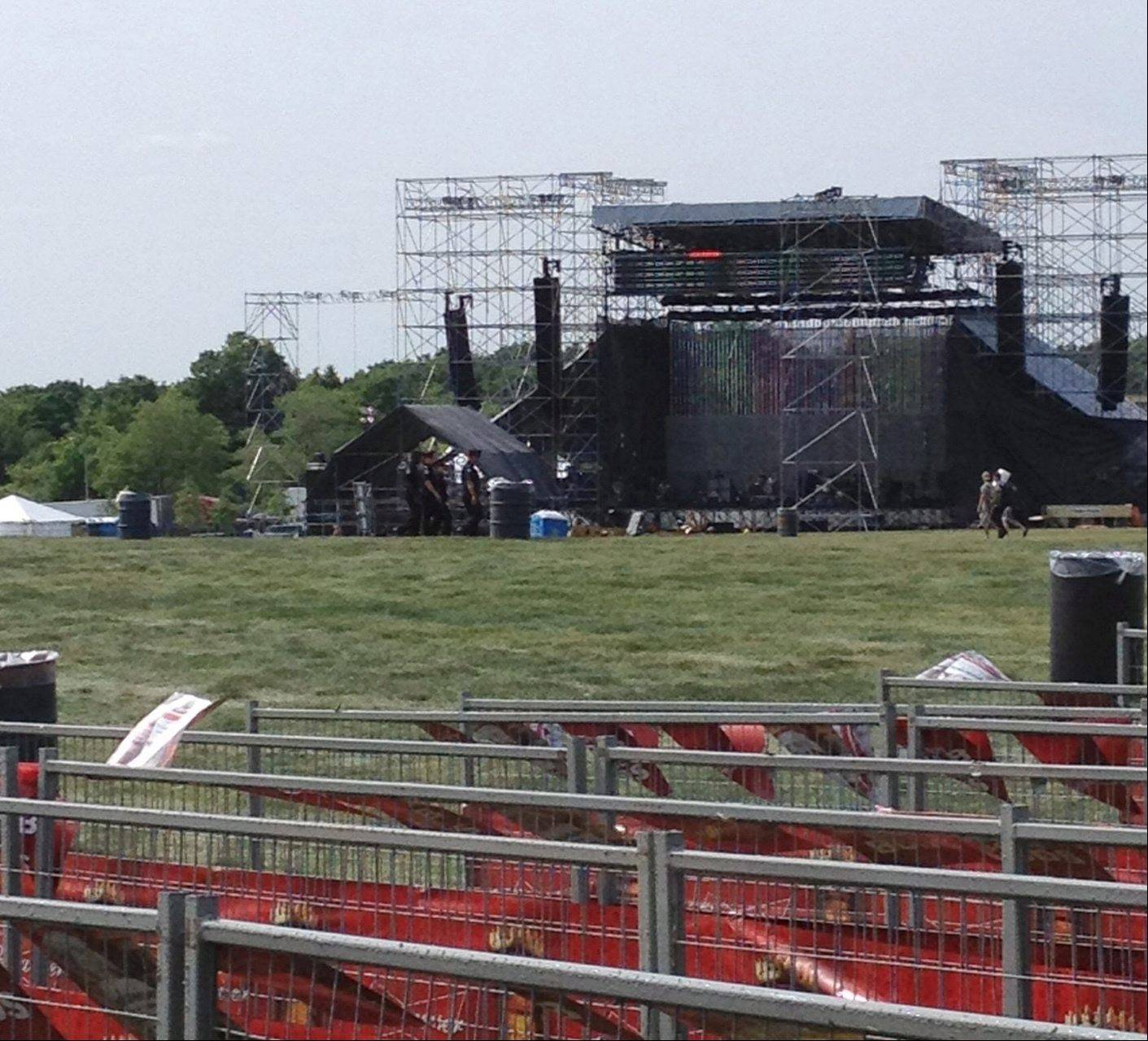 This photo provided by Alexandra Mihan shows a stage before it collapsed at the site for a Radiohead concert at Downsview Park in Toronto on Saturday, June 16, 2012. Toronto paramedics say one person is dead and another is seriously hurt after the stage collapsed while setting up for a Radiohead concert. They say two other people were injured and are being assessed.