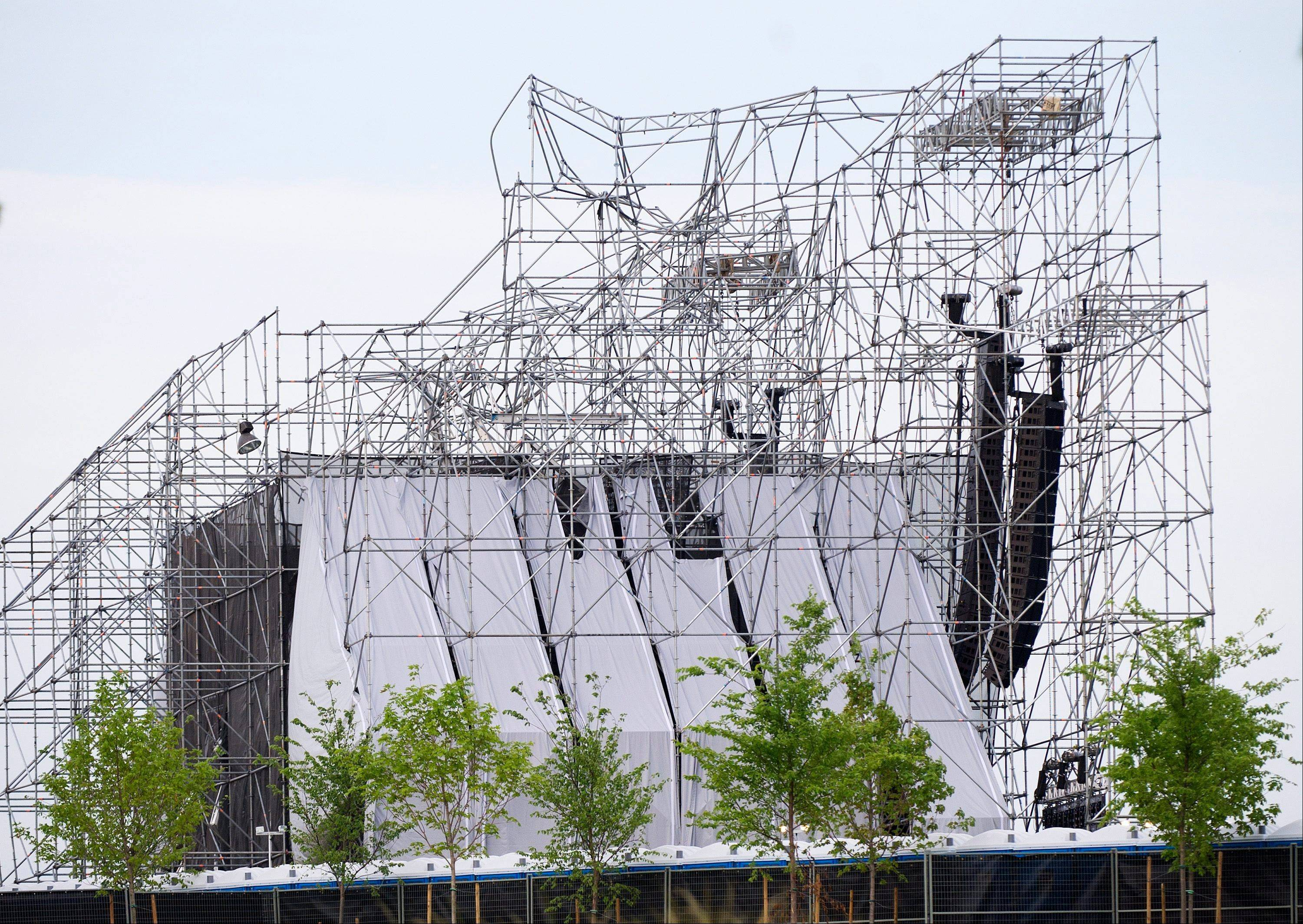 A stage intended for a Radiohead concert is collapsed at Downsview Park in Toronto on Saturday, June 16, 2012. Toronto paramedics say one person is dead and another is seriously hurt after the stage collapsed while setting up for a Radiohead concert. They say two other people were injured and are being assessed.