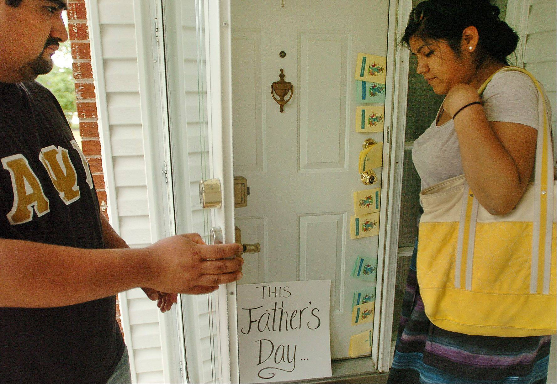 Bob Chwedyk/bchwedyk@dailyherald.comRicardo Serrano, left, and Maria Salazar along with members of the Illinois Coalition for Immigrant and Refugee Rights deliver Father's Day cards and letters to state Rep. Fred Crespo's home Saturday in protest of his policies on immigration.