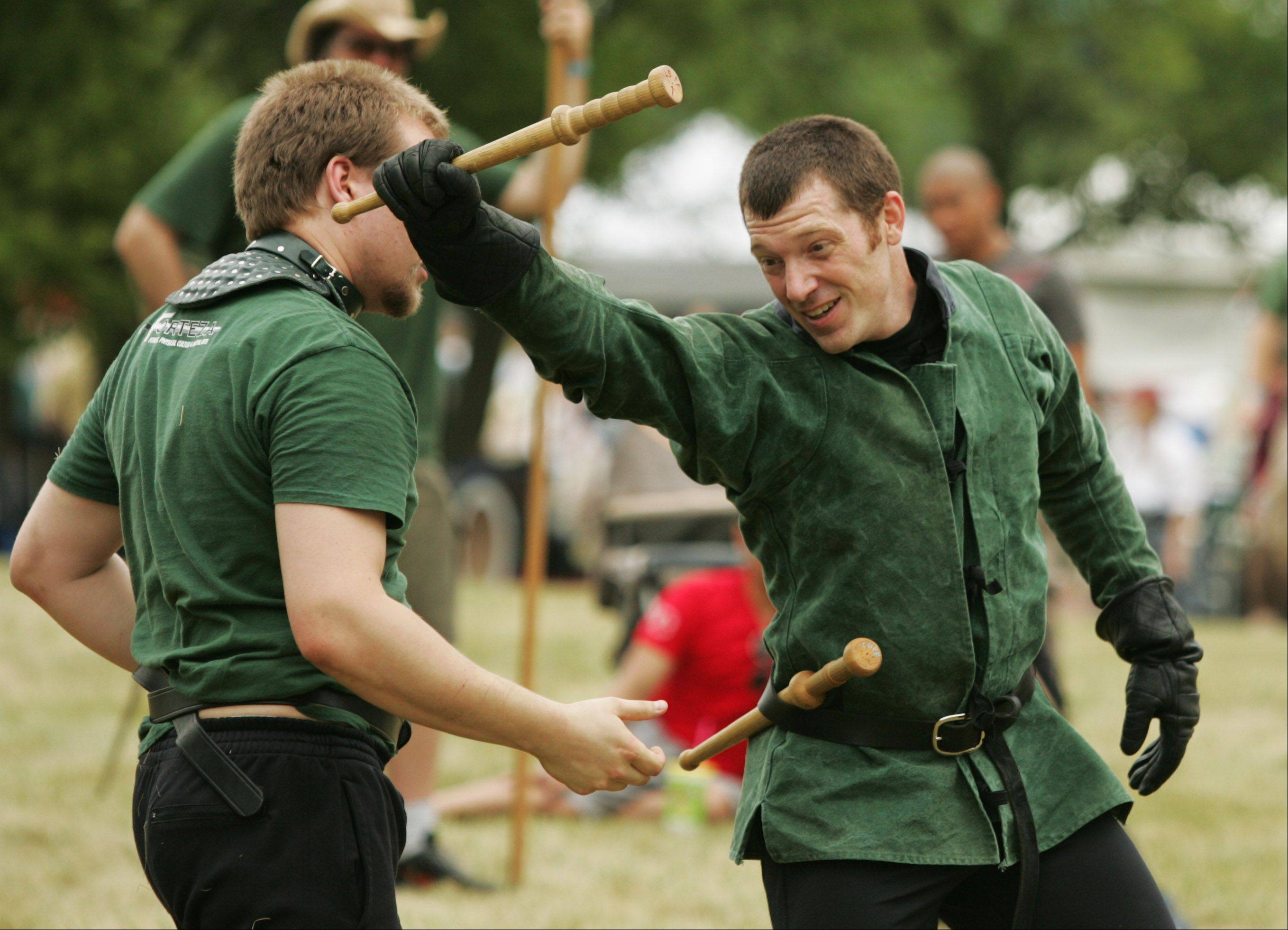 Nathan Wisniewski of Arlington Heights and Jesse Kulla of Chicago, members of the Chicago Swordplay Guild, demonstrate techniques Saturday during the second day of the 26th annual Illinois St. Andrew Society Scottish Festival and Highland Games at Hamilton Lakes in Itasca. The event was expected to draw between 12,000 and 15,000 people.