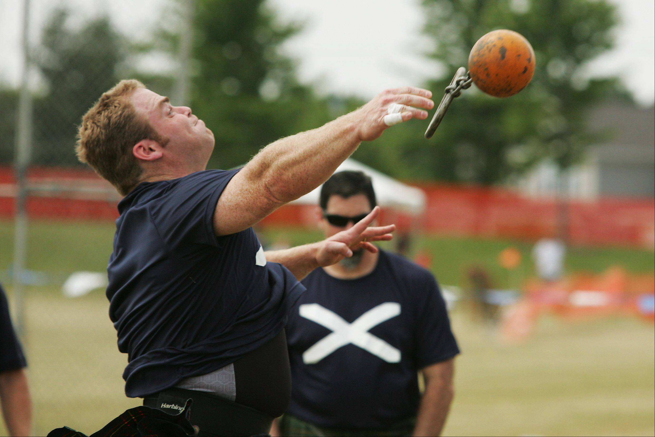 Daniel McKim of Kansas City, Mo., finishes second in the 28-pound weight throw for distance event Saturday during the Illinois St. Andrew Society Scottish Festival and Highland Games at Hamilton Lakes in Itasca.