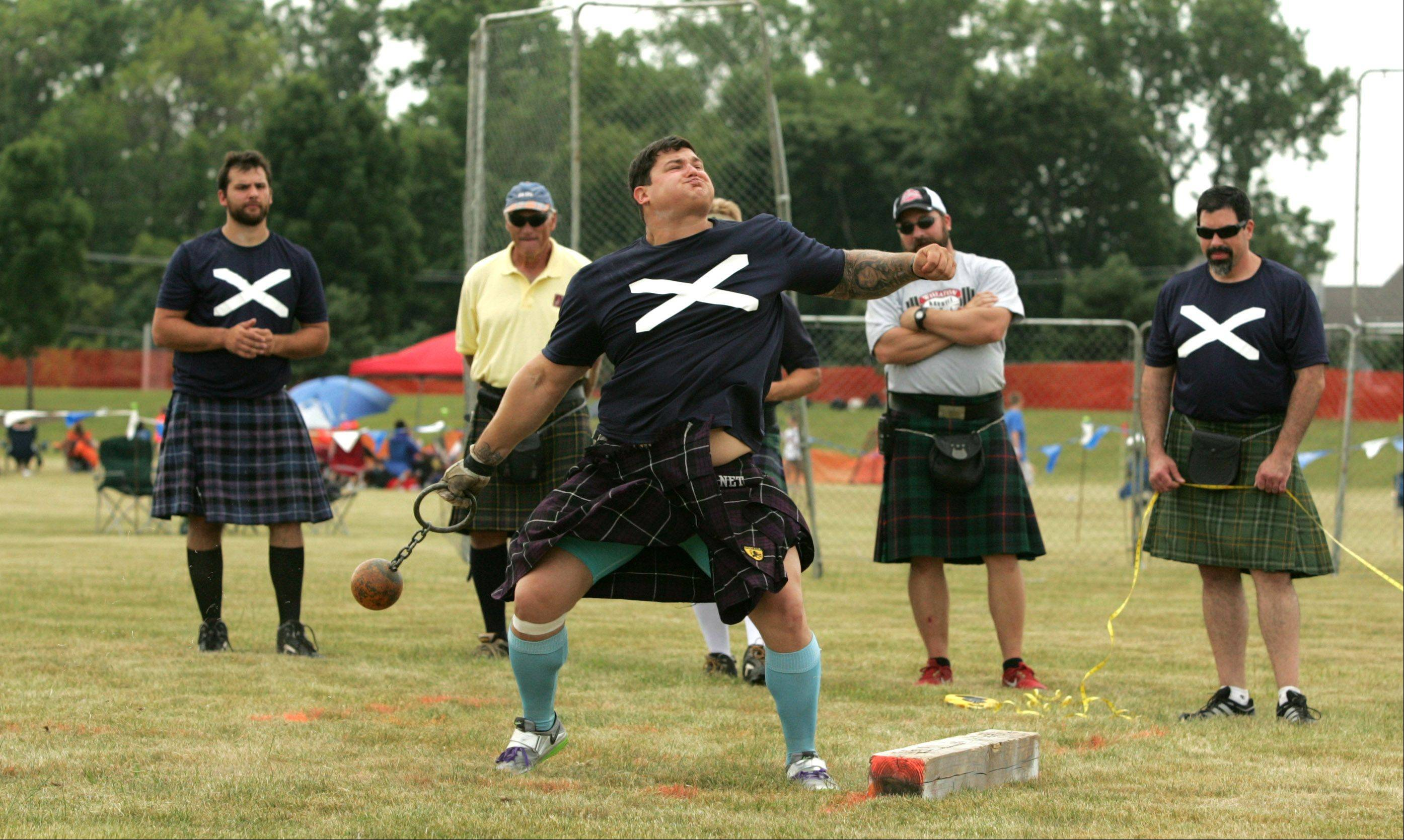 Matt Vincent of Baton Rouge, La., wins the 28-pound weight throw for distance event during heavy athletics competitions Saturday at the 26th annual Illinois St. Andrew Society Scottish Festival and Highland Games. His 91-foot, 10-inch toss won the event, setting a new course record.