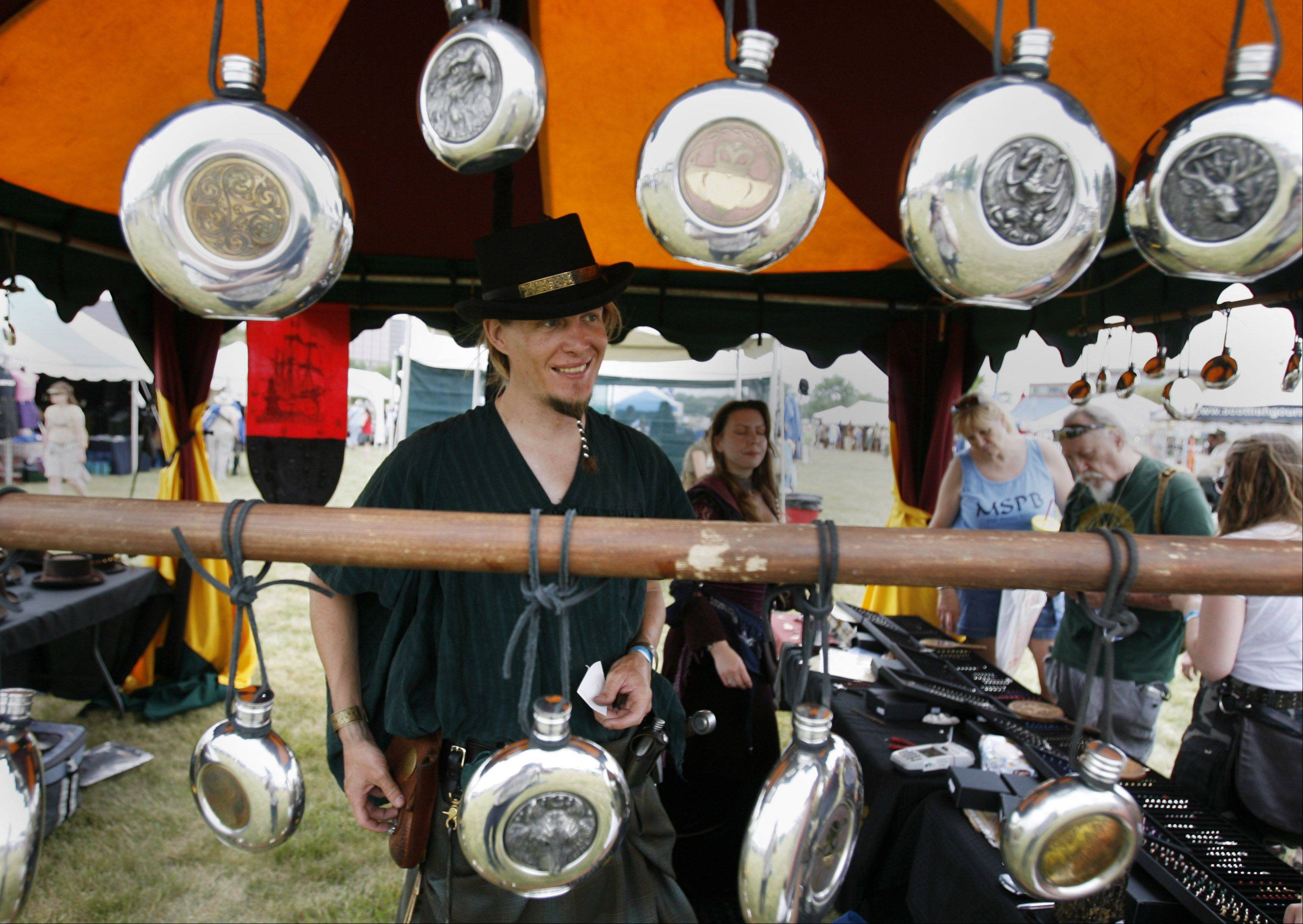 Henning Hogue of Single Tree Celtic jewelry sells flasks Saturday during the Illinois St. Andrew Society Scottish Festival and Highland Games.