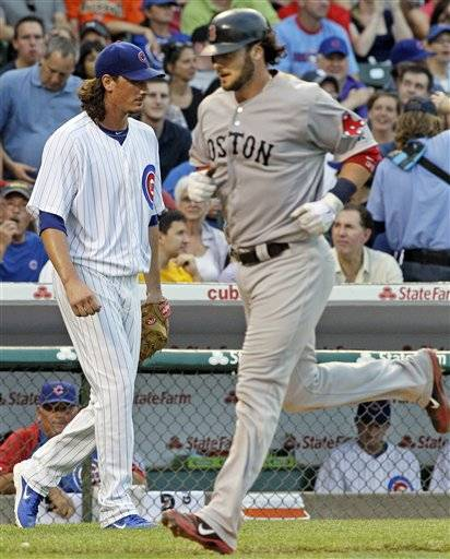 Starter Jeff Samardzija, left, can't bear to watch as Boston Red Sox's Jarrod Saltalamacchia rounds the bases after hitting a two-run home run during the fourth inning Saturday at Wrigley Field.