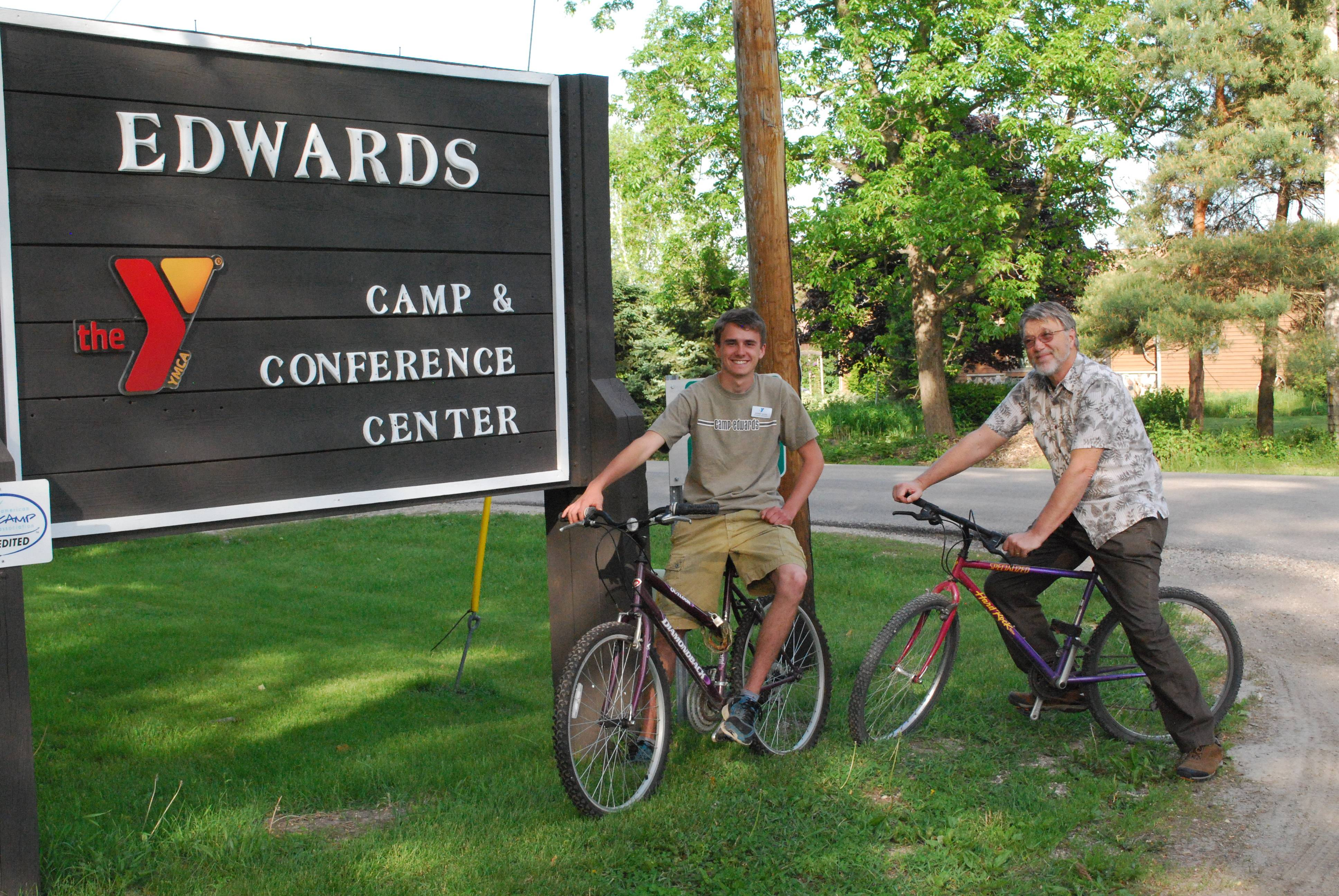 Dan Kerr (left) and David Wedemeyer, both members of Camp Edwards' The Tribe of the Nani Ba Zhu, make sure their legs and bicycle equipment are in shape for the June 16 Bike for Kids fund raising event.  David serves on the Camp Edwards Board of Managers and Dan is a member of the Camp Edwards environmental education staff working with visiting school groups.