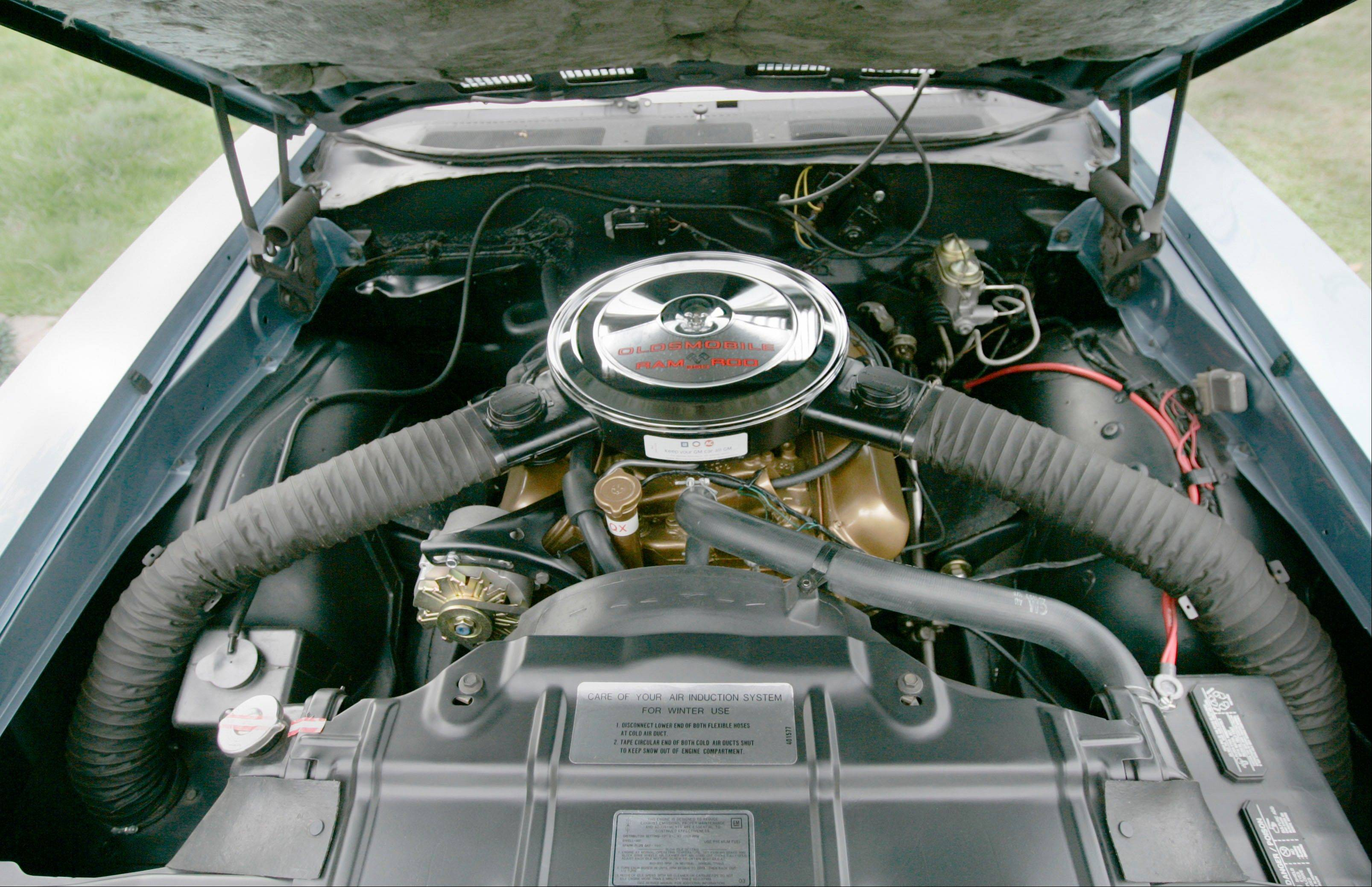 The engine compartment of Scott Pierce's 1969 Oldsmobile F-85 with the W-31 engine performance package, in Meriden, Conn. Back when gas was cheap, Americans bought cars with V-8 engines.