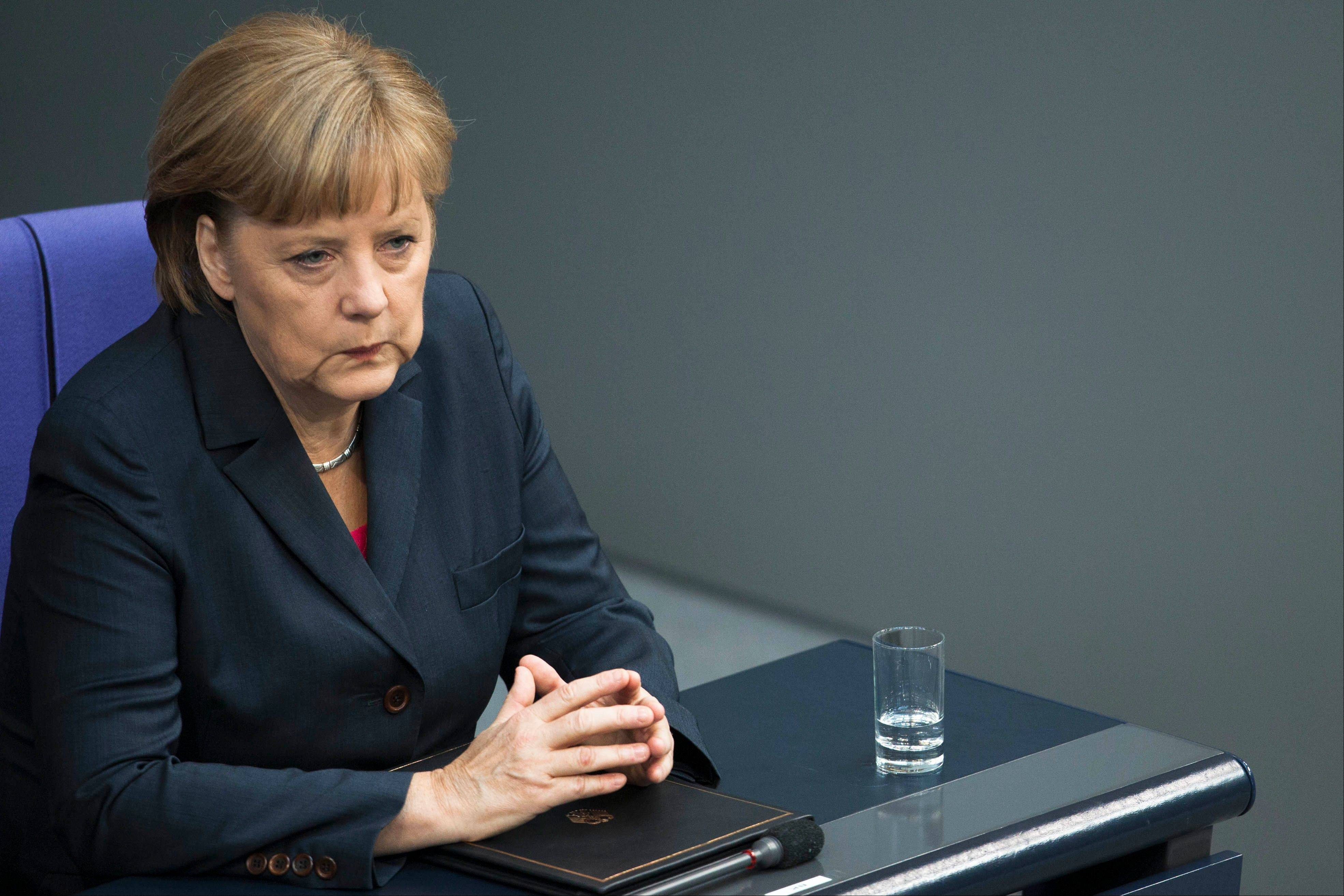 Associated PressGerman Chancellor Angela Merkel reacts before her speech prior to this weekend's G20 summit at the Bundestag in Berlin.