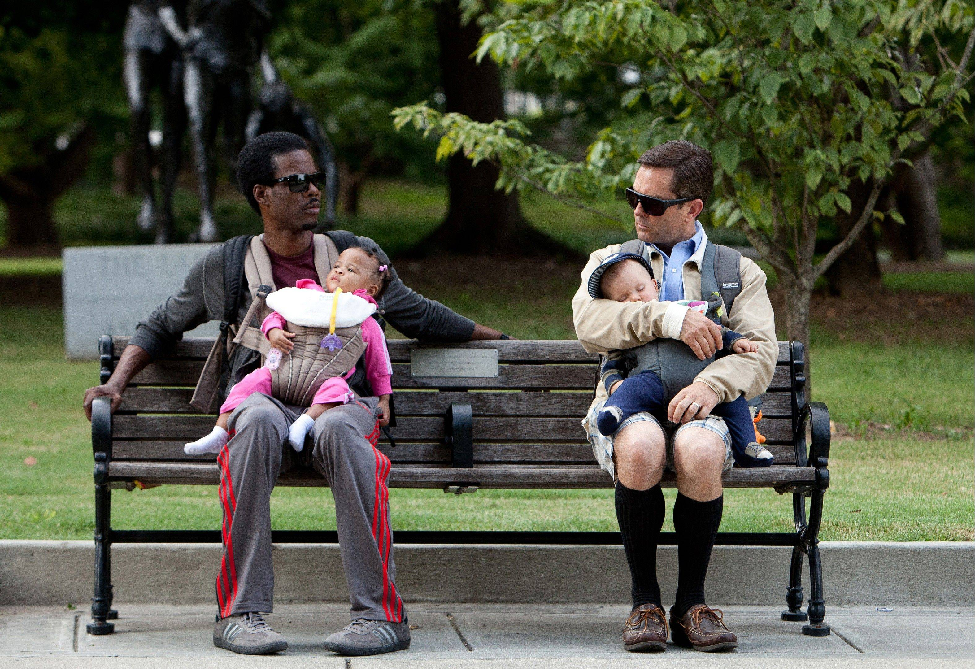 "Chris Rock, left, and Tom Lennon with children in a scene from the movie ""What to Expect When You're Expecting."" A growing league of dads are staying home, at least part-time. Some at-home dads, those by choice or pushed out of the job market, said they've endured some snark by their working brethren, but they consider it more of a dad-on-dad discomfort than a serious divide."