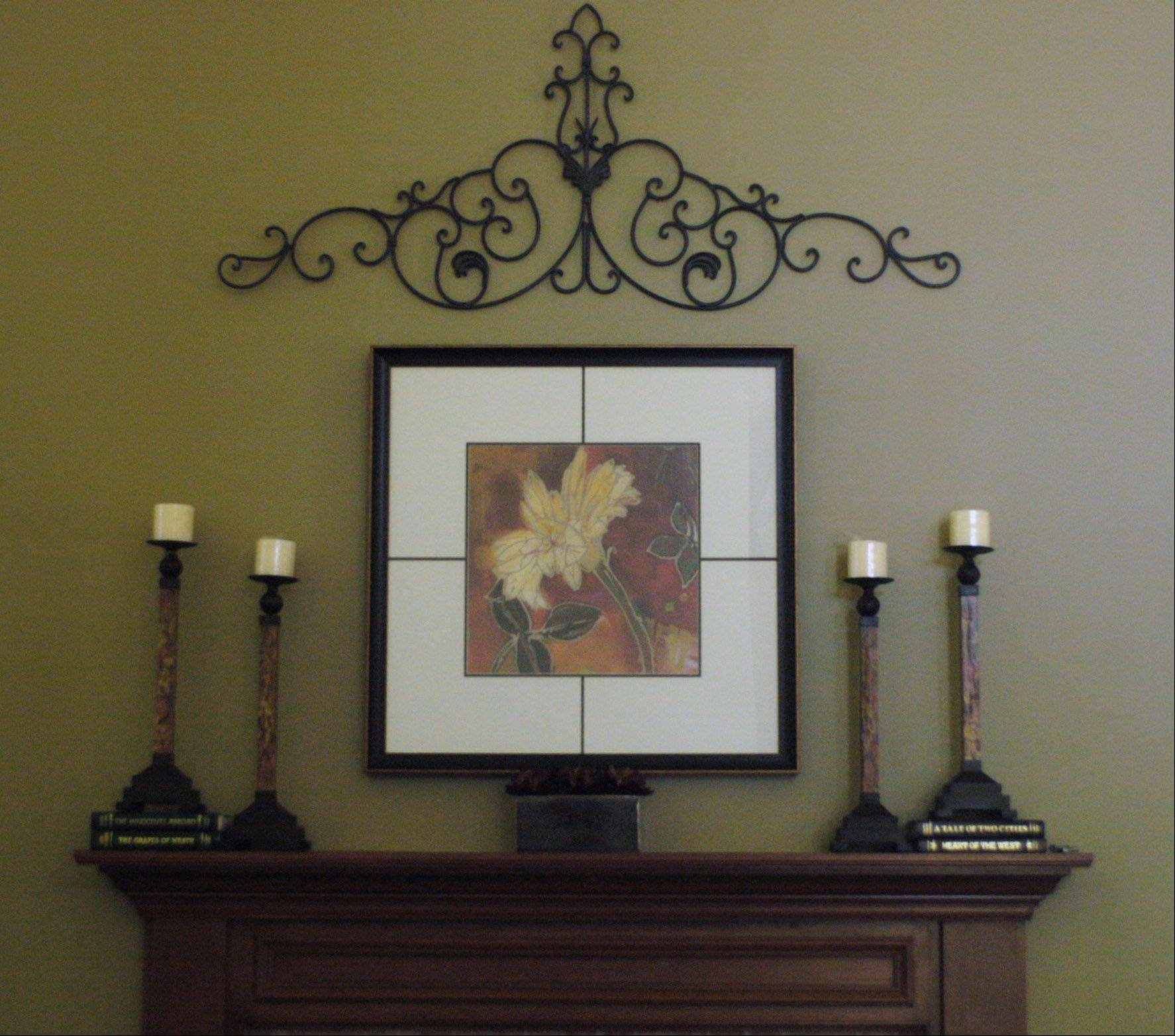 Deb Goetz likes the mixture of materials and symmetry of the vignette on the mantel.